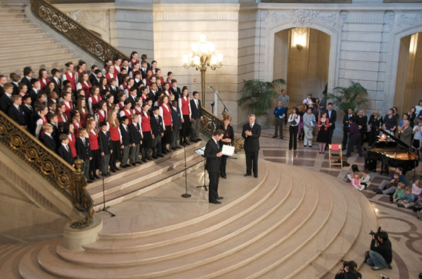 """Mayor Gavin Newsom congratulates SFGC and SFBC after their """"send-off"""" concert, conducted by Ian and Susan McMane, at SF City Hall before traveling to Washington, D.C. in 2009."""