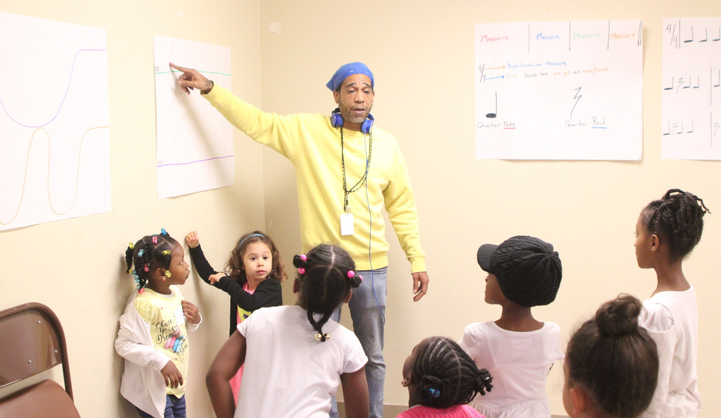 SFGC Teaching Artist Christopher Street works with choristers in SFGC's Bayview Chorus Program.