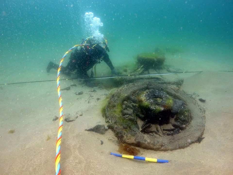 Divers recover a gun carriage wheel used to position cannon on a Spanish Armada gunship at Streedagh Beach, Sligo in 2015. Photo courtesy Underwater Archaeology Unit, National Monuments Service.