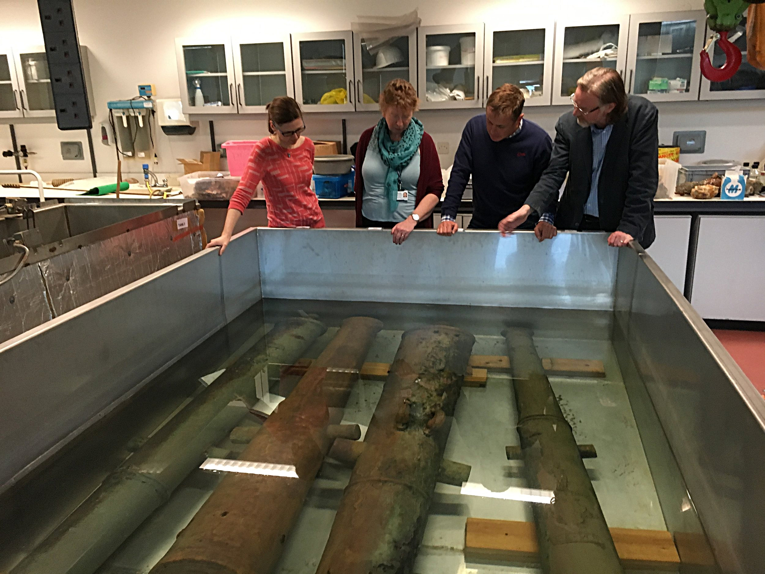 With (l-r) conservation team Hannah Power, Nessa O'Connor and Fionnbarr Moore discussing the Spanish Armada cannon from Streedagh at the National Museum in Dublin 29.10.'17