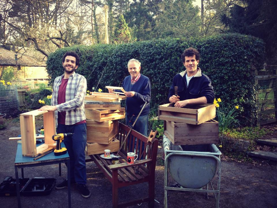 Knocking up a beehive. Tom Noble, Deryk Noble and Simon Noble.