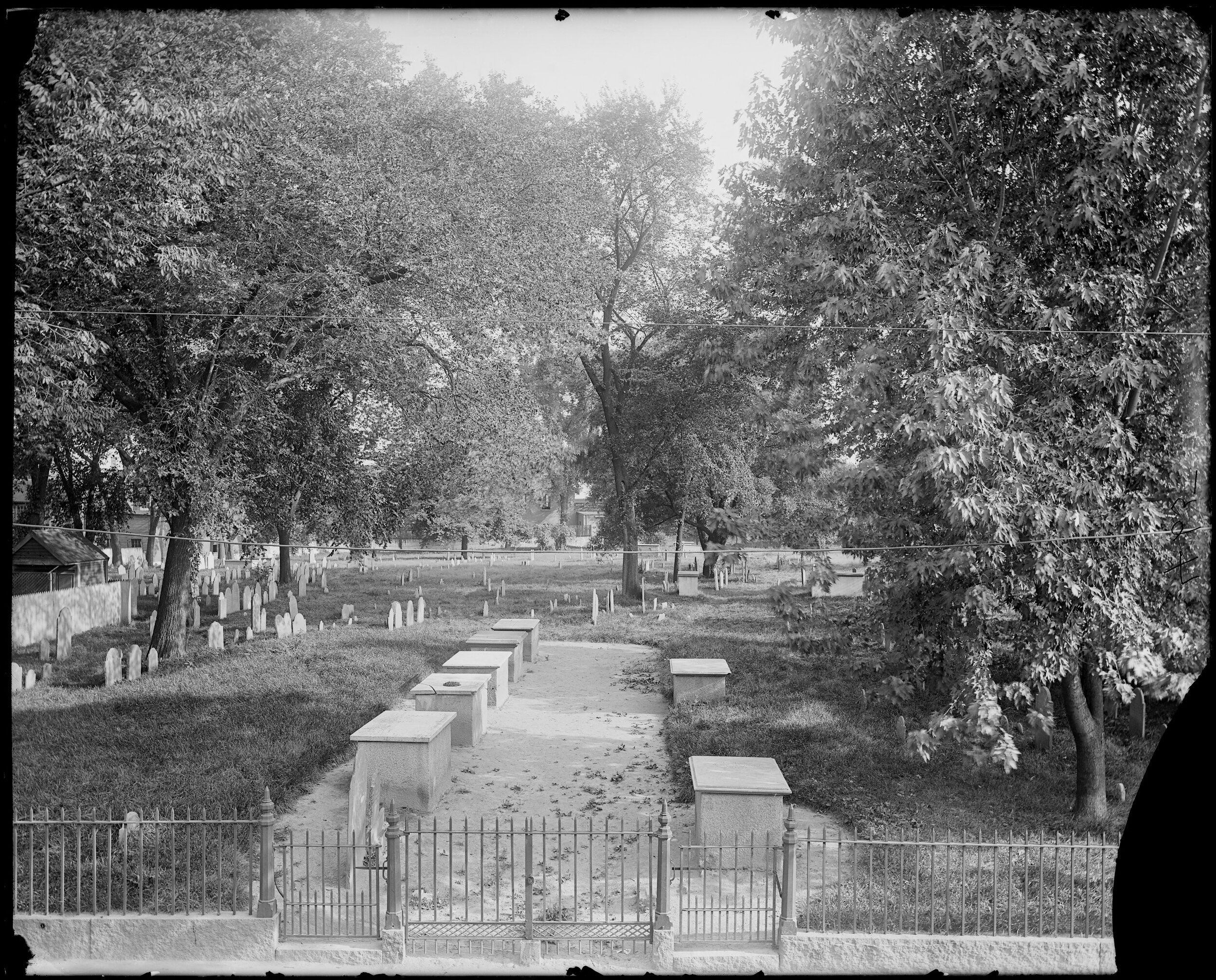 CHARTER STREET CEMETERY ENTRANCE    Frank Cousins, [Monuments, Salem, Charter Street Cemetery], [1864-1914], Frank Cousins Collection of Glass Plate Negatives, Courtesy of Phillips Library, Peabody Essex Museum, Salem, MA.