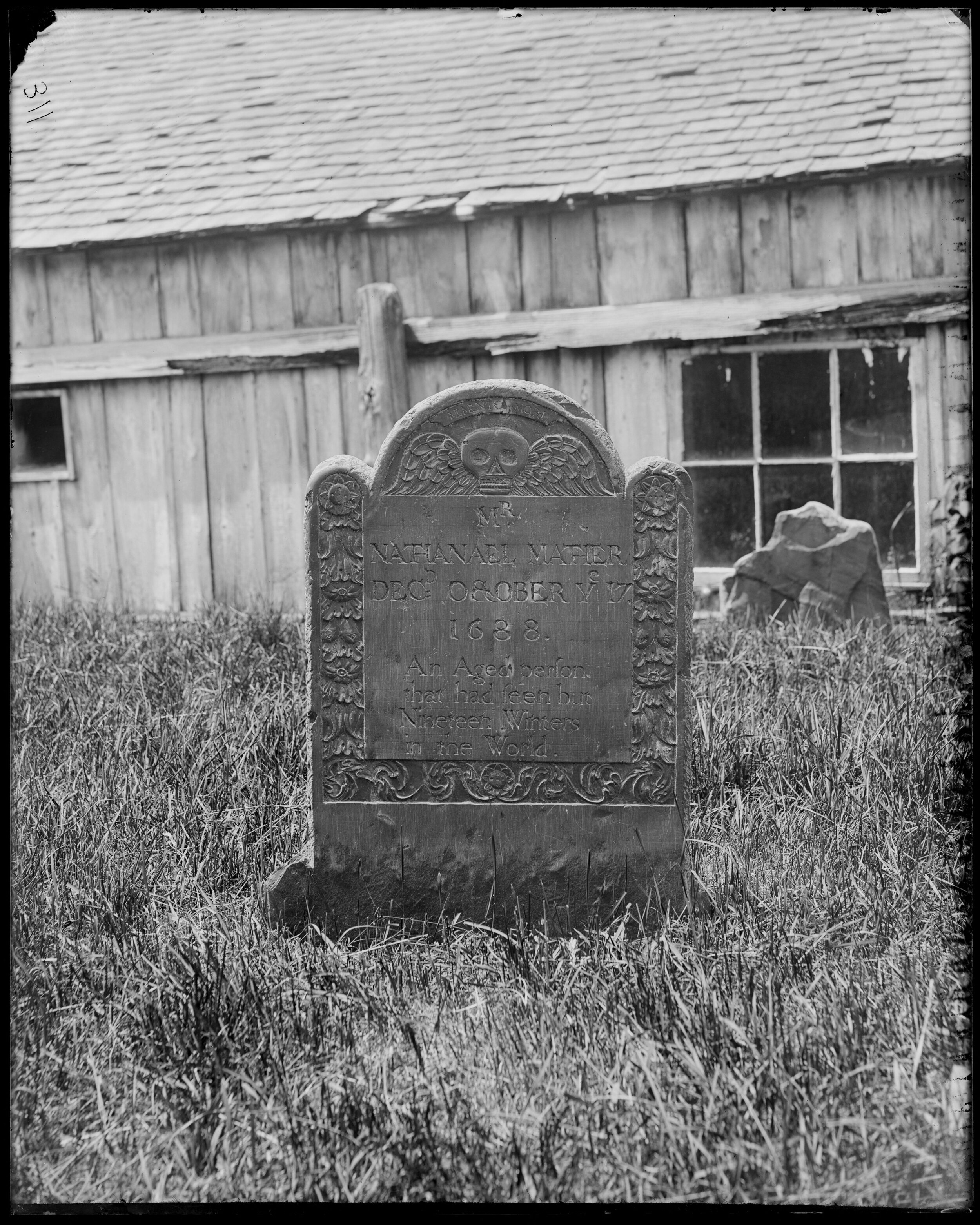 """NATHANIEL MATHER   Son of Increase Mather and brother of Cotton Mather, famous Puritan ministers. Inscription reads """"An Aged Person that has seen but 19 winters in this world"""". Nathaniel entered Harvard College at the age of 12, graduated at 16 and died at 19. Stone was carved by William Mumford.   Frank Cousins, (Monuments, Nathaniel Mather grave, Salem, Charter Street Cemetery], [1864-1914], Frank Cousins Collection of Glass Plate Negatives, Courtesy of Phillips Library, Peabody Essex Museum, Salem, MA."""