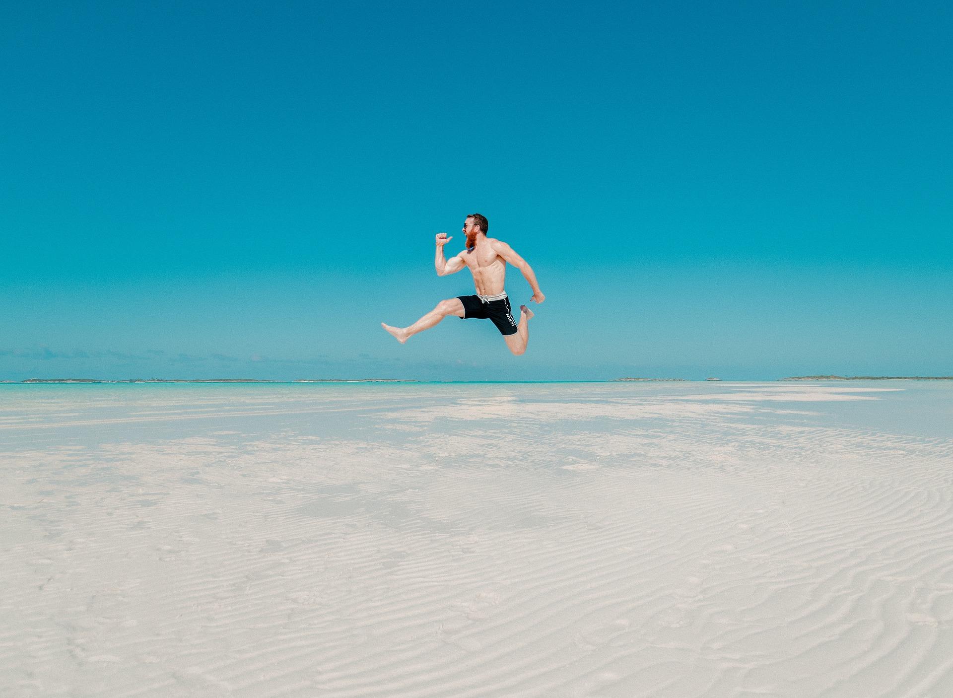man-jumping-on-the-beach-to-boost-self-esteem.jpg