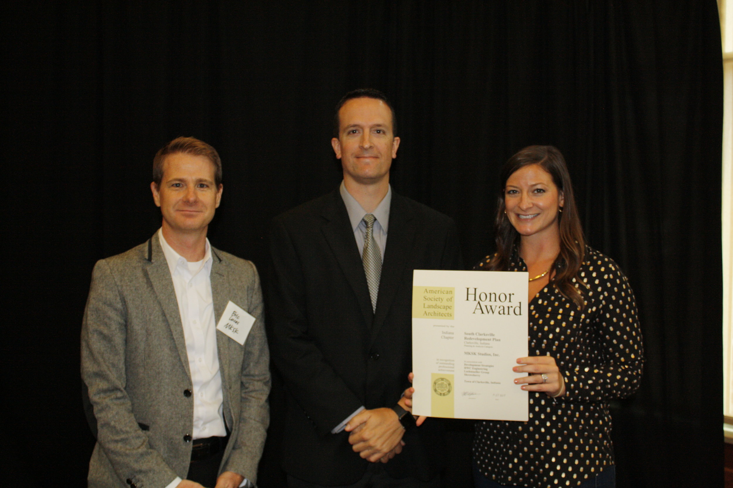 Eric (Principal Landscape Architect, MKSK) and Julie Barnard (Landscape Architect, MKSK) receive the Planning and Analysis Honor Award from Bill Kincius (INASLA President), for the South Clarksville Redevelopment Plan