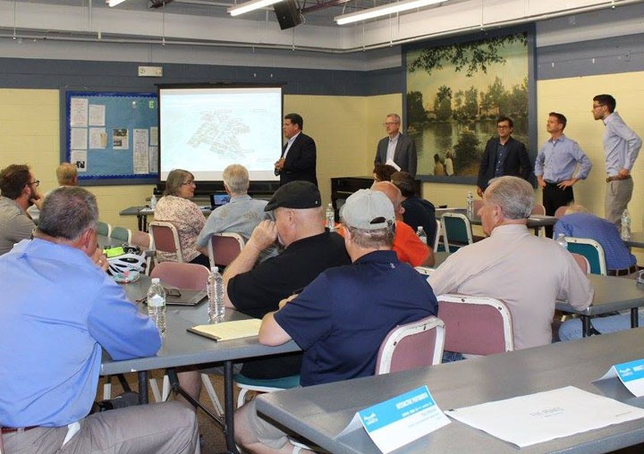 The Mayor and Planning Team discuss opportunities and analysis as part of an interactive workshop with area residents. Over 60 residents attended this two hour workshop.
