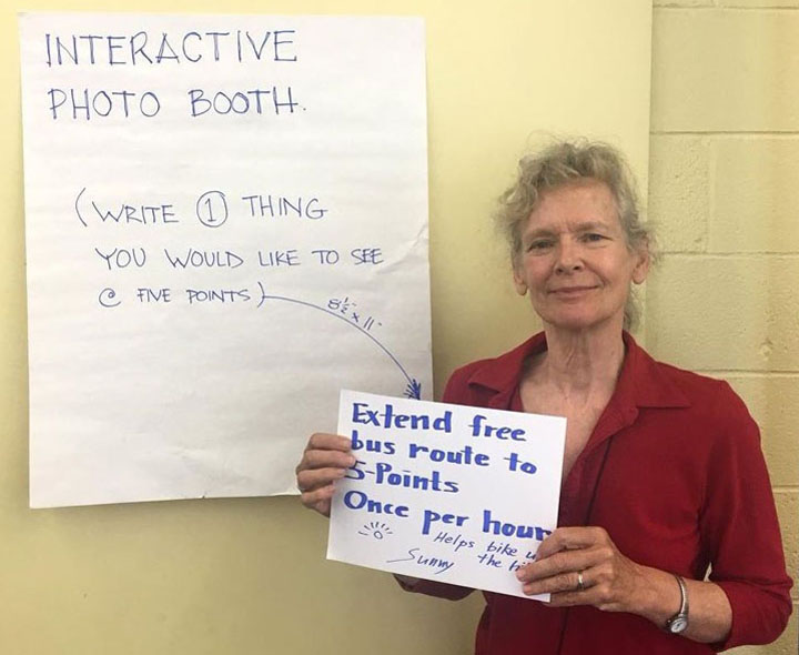 Area resident participates in an interactive photo booth activity.