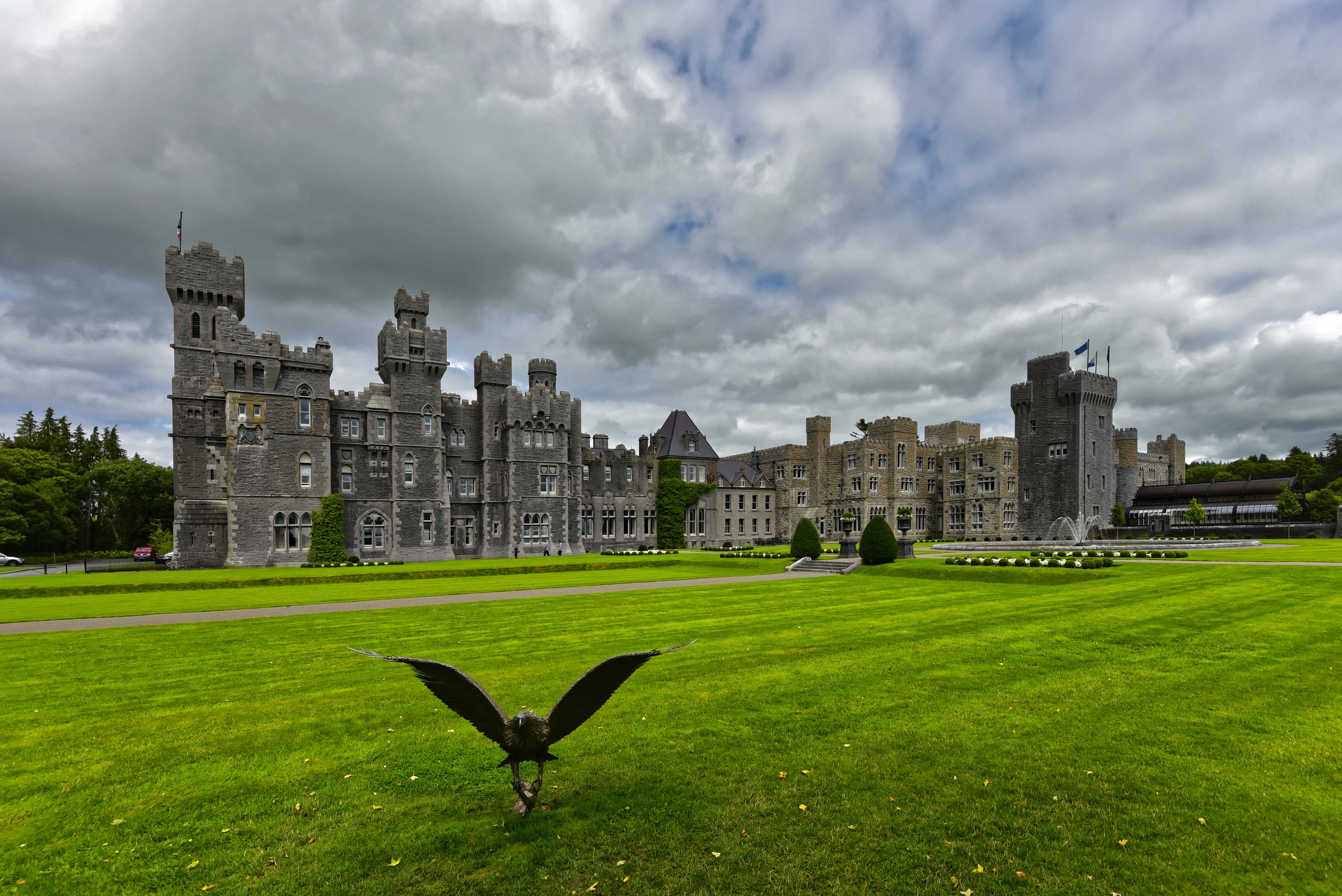 May 30:Ashford Castle12p - Hawk Walk2pm- Lunch reservations(inside Ashford Castle) - You'll check out of your hotel this morning and travel to Ashford Castle!Massive, flamboyantly turreted, Ashford is the very picture of a romantic Irish castle. This famed mock-Gothic baronial showpiece, dating from the 13th century, and rebuilt in 1870 for the Guinness family, has been wowing visitors like President Reagan, John Travolta, Brad Pitt, and Pierce Brosnan—who got married here—ever since.Nearly bigger than the entire neighboring village of Cong, it is strong on luxury and service, yet maintains a relaxed atmosphere in which guests of all ages feel totally at ease. Kids immediately associate the castle with Hogwarts... and better yet, you don't have to stay here to see the grounds!While a small fee will allow you entrance to the grounds and gardens, lunch reservations will allow you a sneak peak inside the castle (closed to guests not staying the night).After your meal, head outside to have a truly unique experience...Ireland's School of Falconry is the oldest established falconry school in Ireland. During your one hour private Hawk Walk,YOU fly their Harris hawks.Your instructor will introduce you to your hawk and, within minutes, you will be setting off around the magnificent woodlands to fly your hawk free. As you fly the hawks, your instructor will explain about the hawks' exceptional eyesight, their speed and agility and how the hawks were trained. The hawks will follow you from tree to tree through the woods before swooping down to land on your gloved fist. This is truly a one of a kind, lifelong memory.Once you have finished exploring Ashford Castle, continue on your day by driving north to Northern Ireland.You'll be leaving the country of Ireland and entering Northern Ireland. The border is almost non-existent (you'll know you are in Northern Ireland when the yellow broken line on the left side of the road - changes to a solid white line. ... and when the speed l