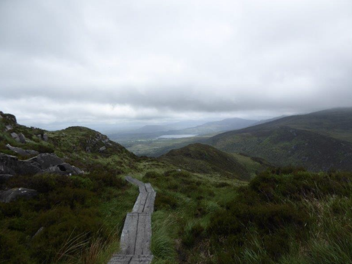 May 24:HIKE THE KERRY WAY THROUGH BEAUTIFUL KILLARNEY NATIONAL PARK. - This morning, you'll eat breakfast and drive south to Kenmare, where you'll have several options for your day.Choose which experience you'd like to have:One favorite section of the Kerry Way, on the Old Kenmare Road, will lead you through old oak forests, along centuries-old droving roads, past waterfalls, and into remote mountain valleys.Another Kerry Way walk leads to the ancient ruins of Muckross Abbey, down tree-covered serpentine paths beside the shores of Lough Leane and Muckross Lake, and into secluded and rare yew woodlands.Or you may choose the ascent of Torc Mountain, a hike that combines oak woodland, mountain valleys, a waterfall and an unparalleled bird's eye view of the Lakes of Killarney.If you prefer to stay closer to the town, Kenmare is a pretty spot with a neat triangle of streets lined with craft shops, galleries, cafes and good-quality restaurants.Also nearby are the towns of Castletownbere or Kilarney!You'll stay in Kenmare for the next 2 nights.