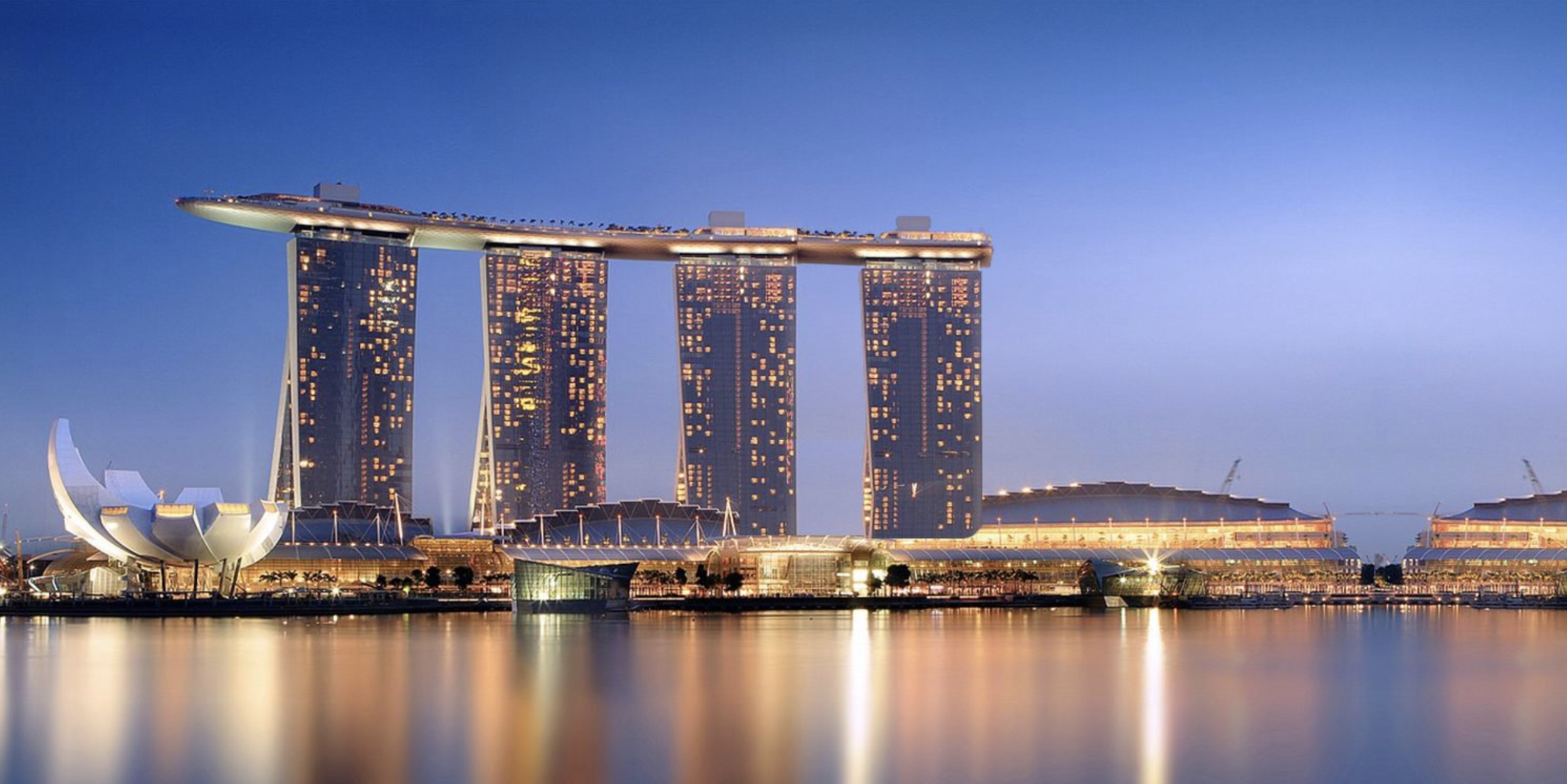 Accommodation: - Marina Bay SandsThis iconic integrated resort boasts luxury accommodations, upscale shopping and an infinity pool with unparalleled views of the city.