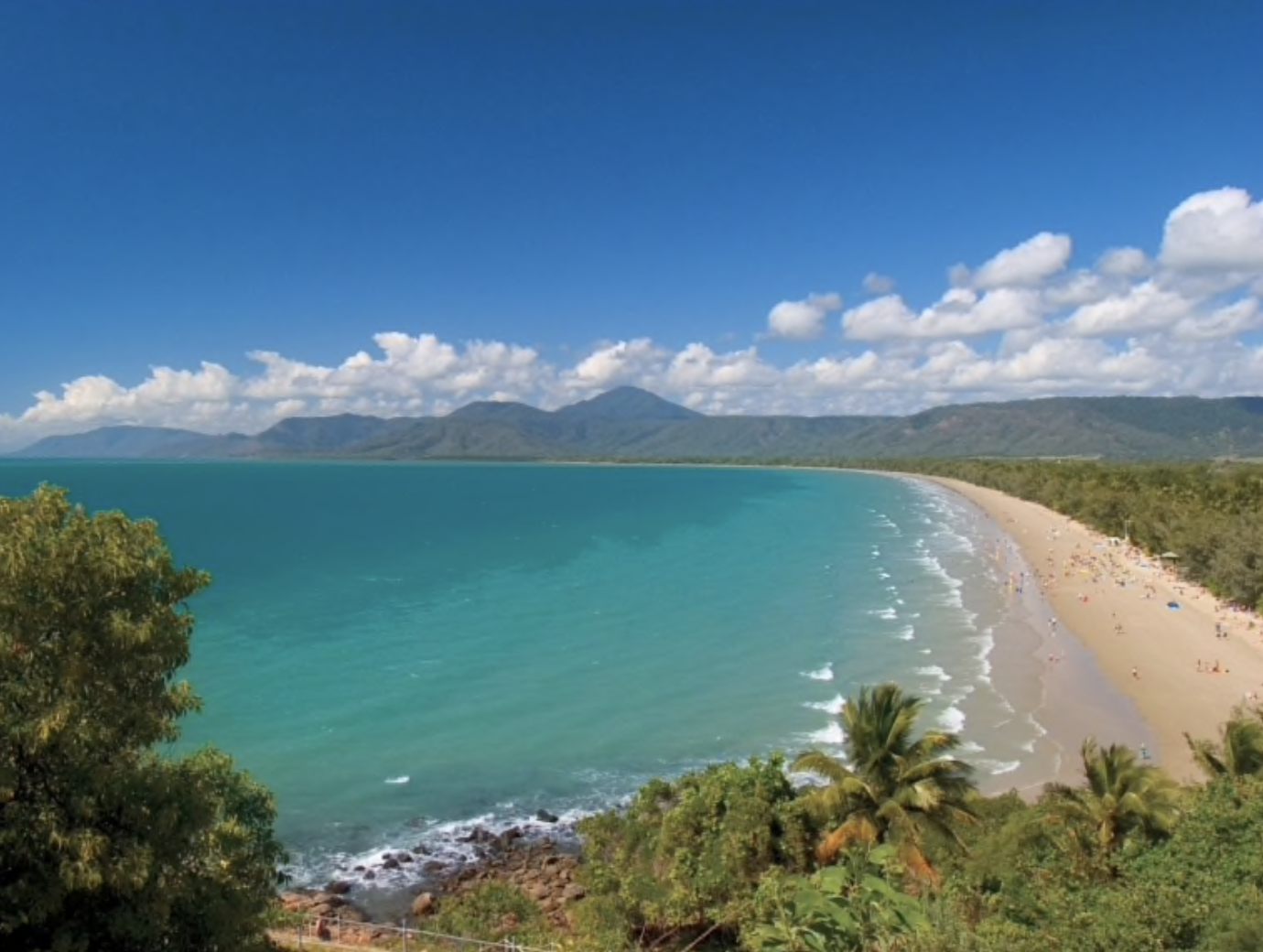 """Four Mile Beach - There's nothing as invigorating as watching the sun come up over an aquamarine ocean. Postcard-perfect and easily accessible, Four Mile Beach curves from the township of Port Douglas. Active types might consider jogging like the locals for whom this beach is a running track. Expect to greet and be greeted; the residents are a friendly lot, even before dawn. A nod of hello or a murmured """"good morning"""" is the perfect way to blend in."""