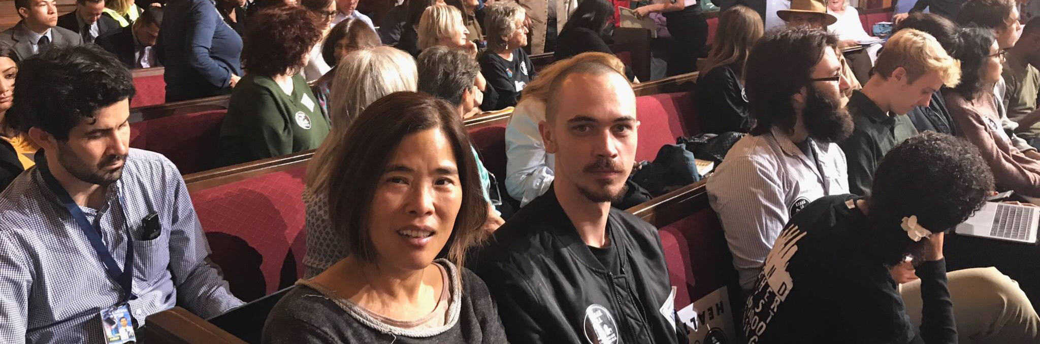 Miles and Li at a hearing for  S.T.A.N.D. L.A.  - to push for a city-wide decision to end neighborhood fossil fuel extraction.