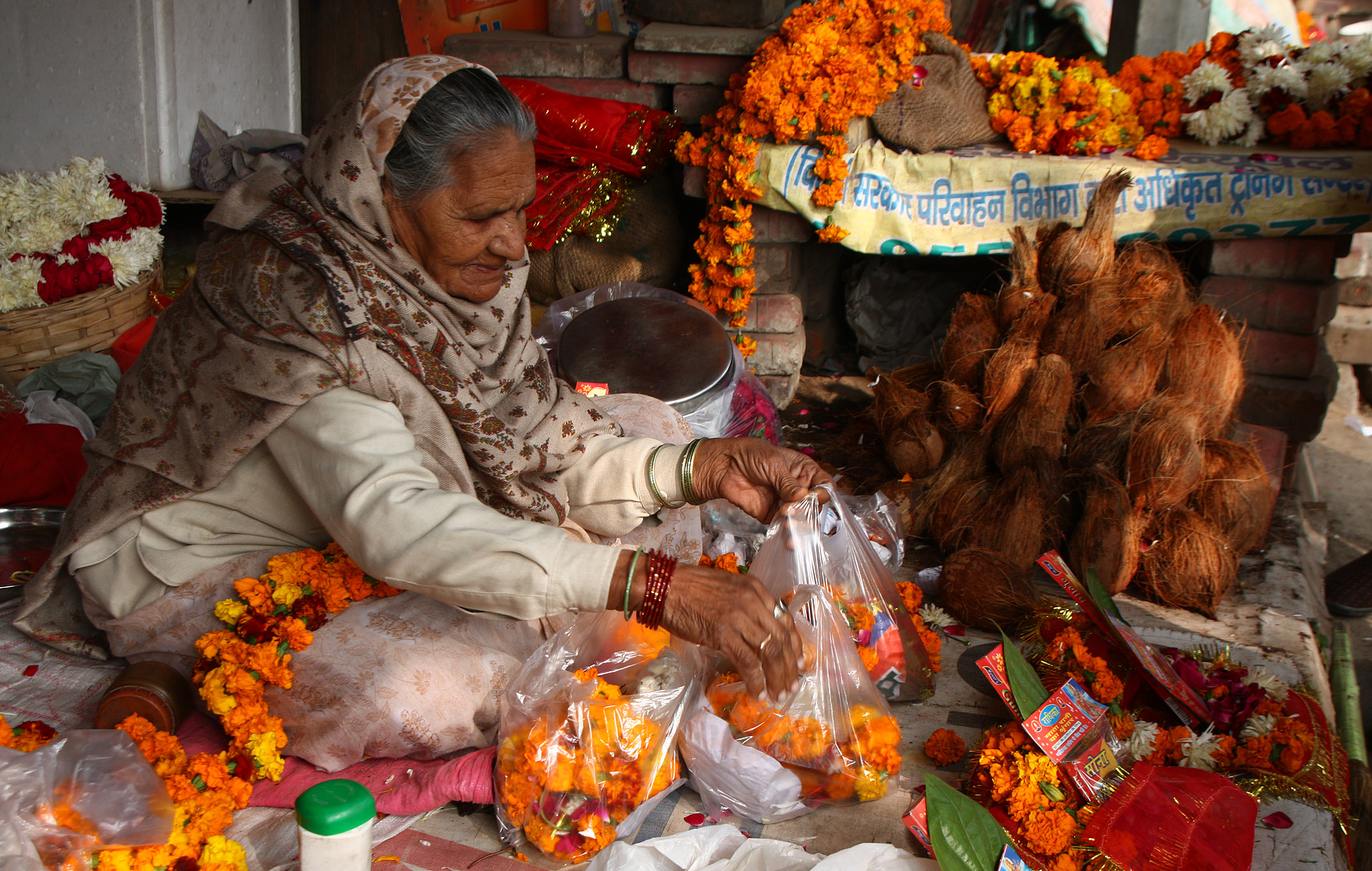 A woman selling flowers, New Delhi, India