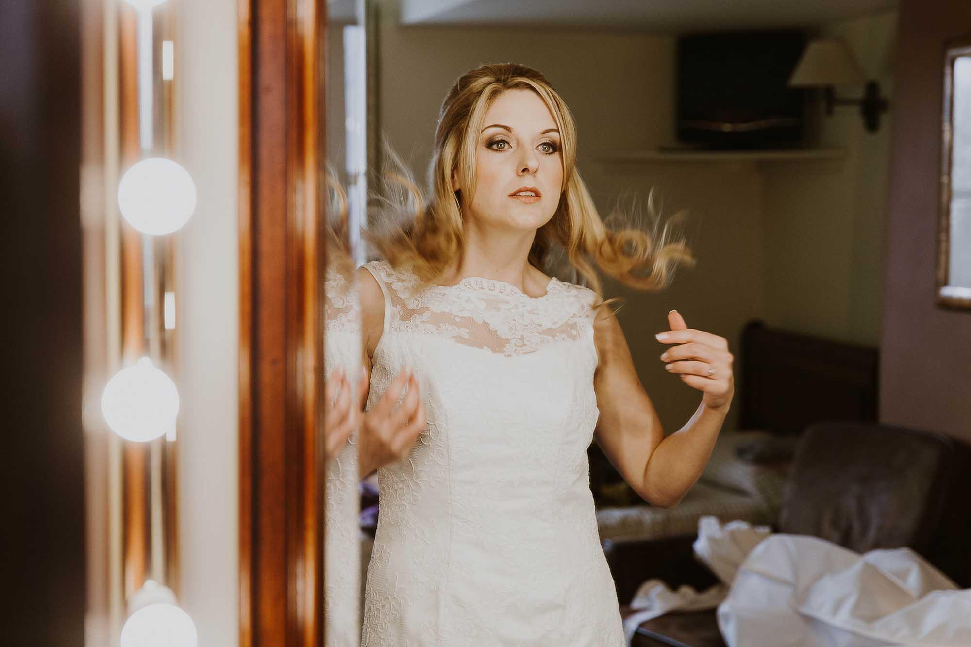 Bride getting ready at The White Hart Inn Lydgate