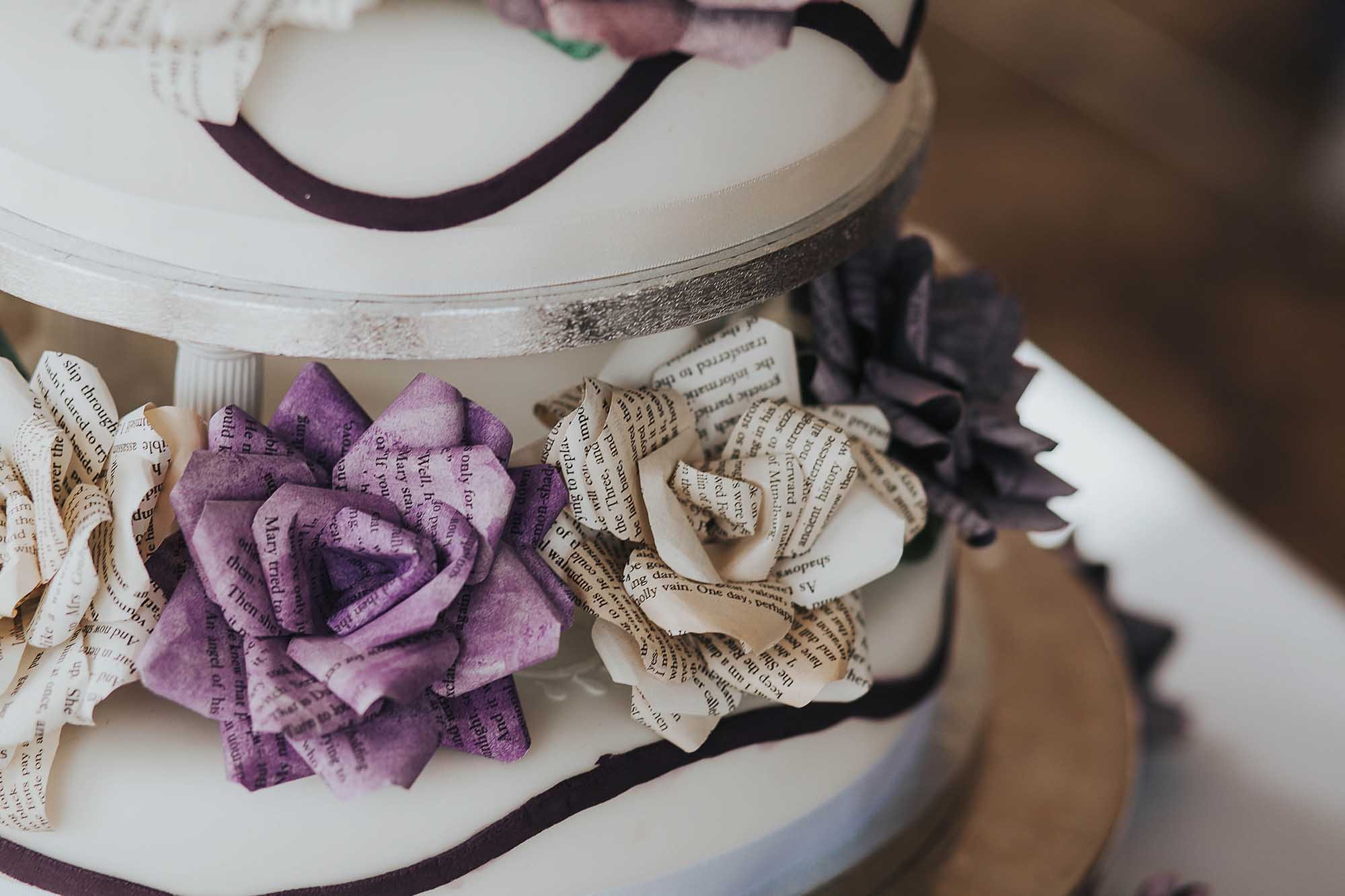 handmade paper flowers on wedding cake