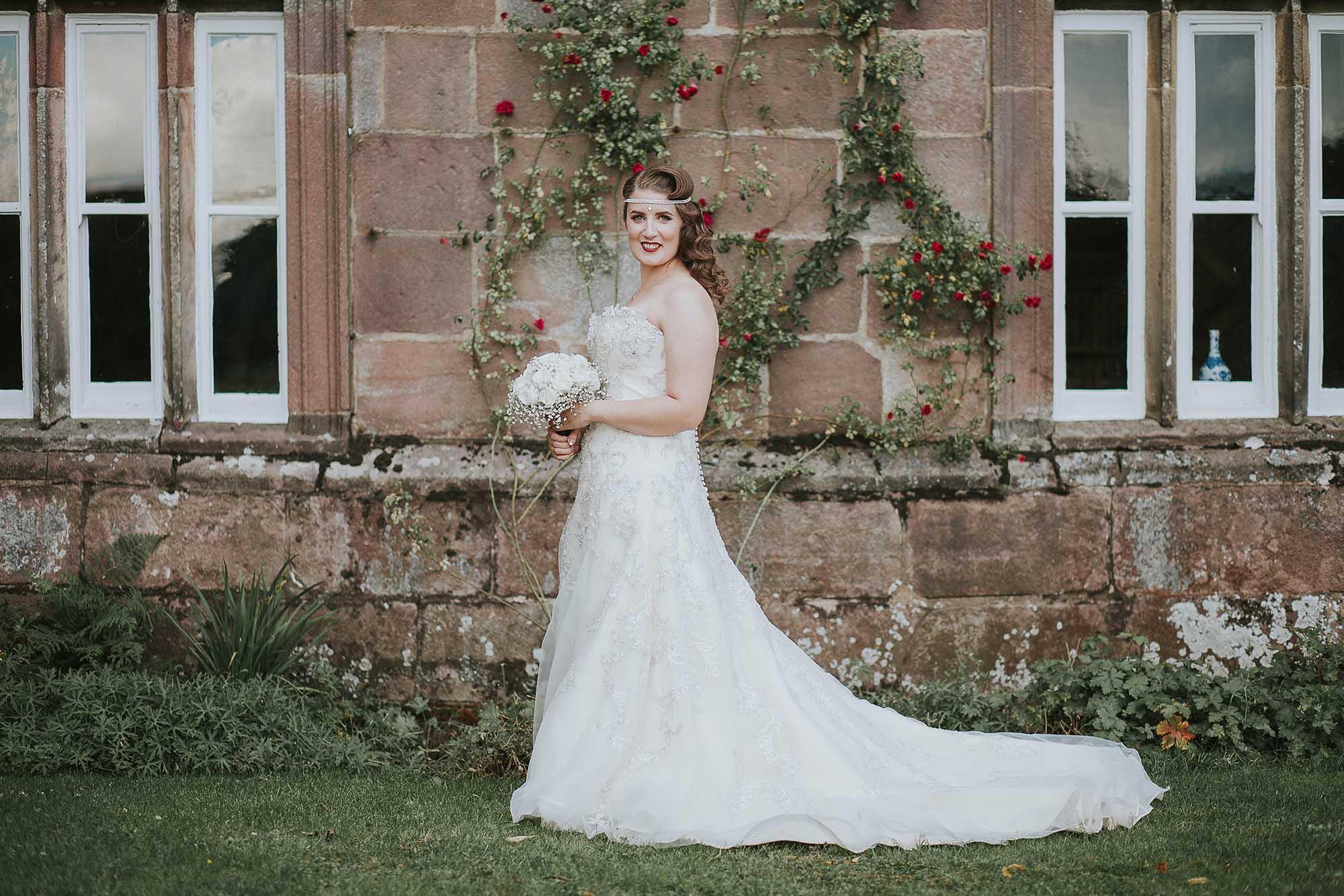 Bride outside Browsholme Hall and Tithe Barn
