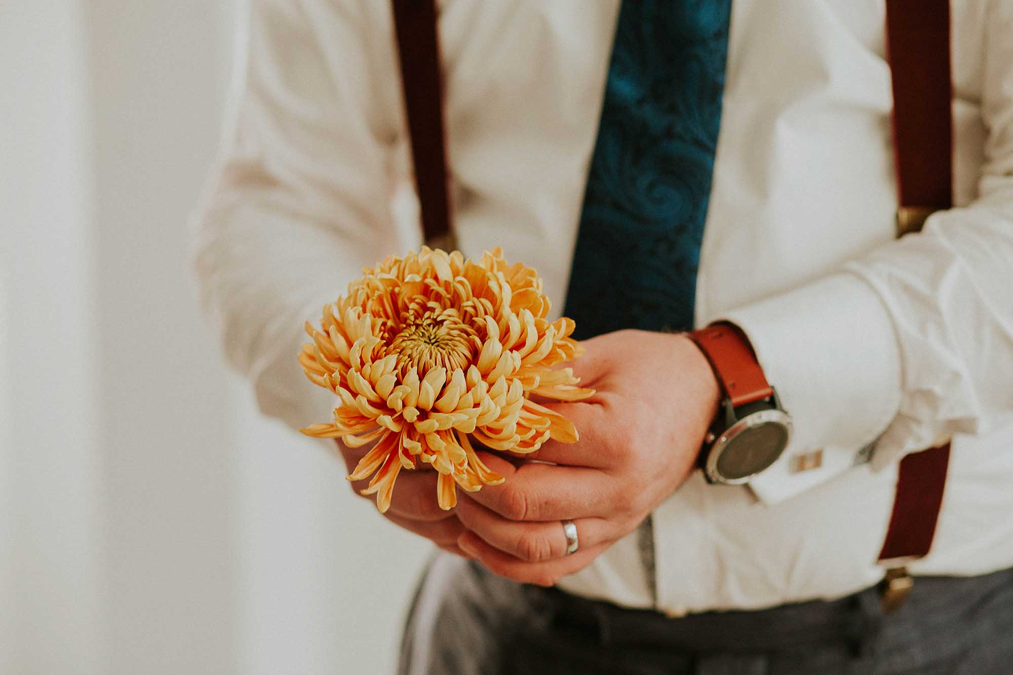 groomsman holds flower Sheffield wedding