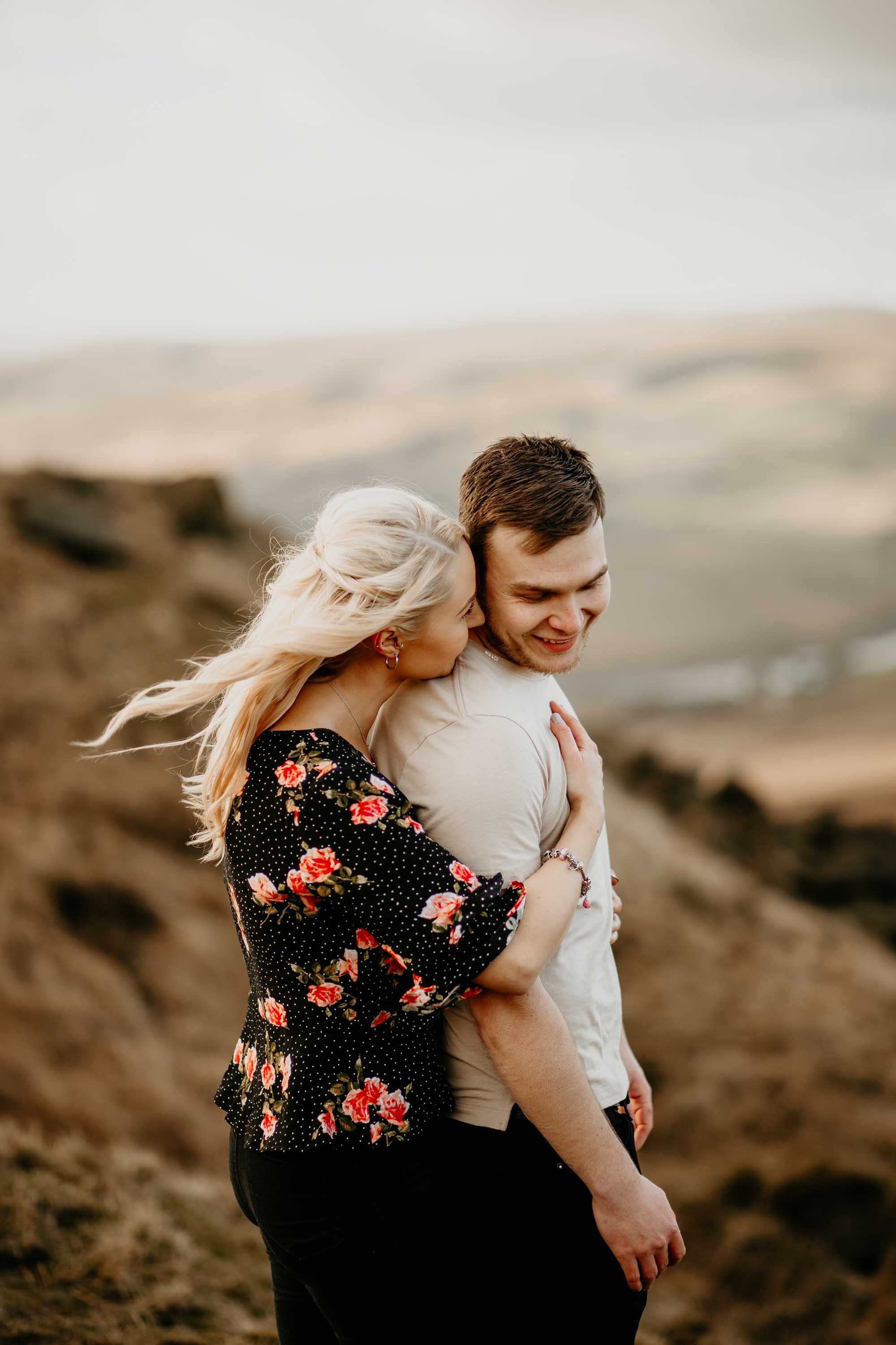 couple on moorland engagement shoot in Littleborough