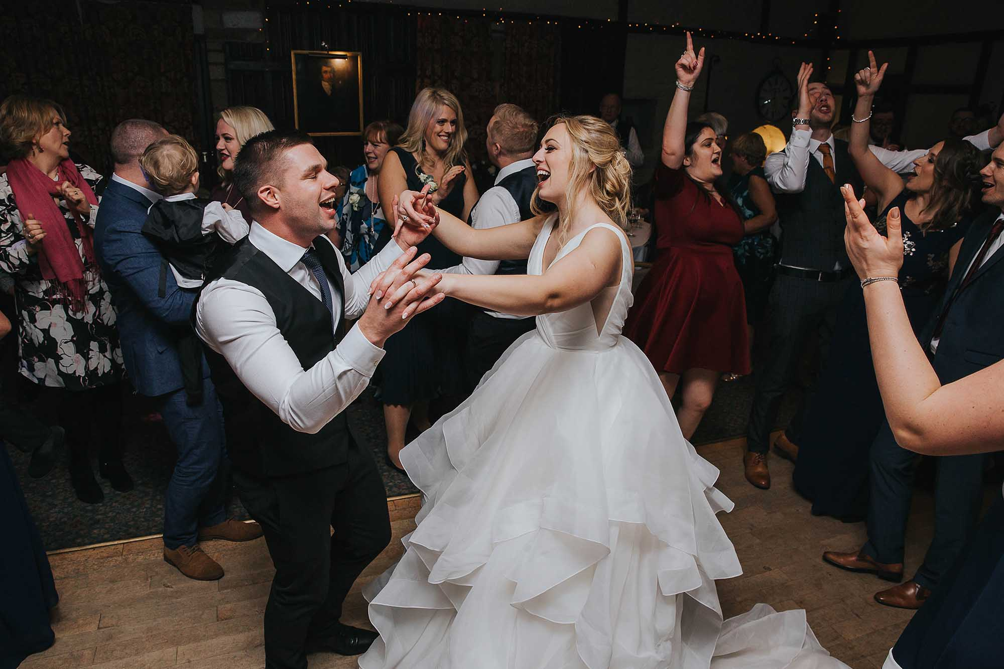bride and groom dancing at Holdsworth House