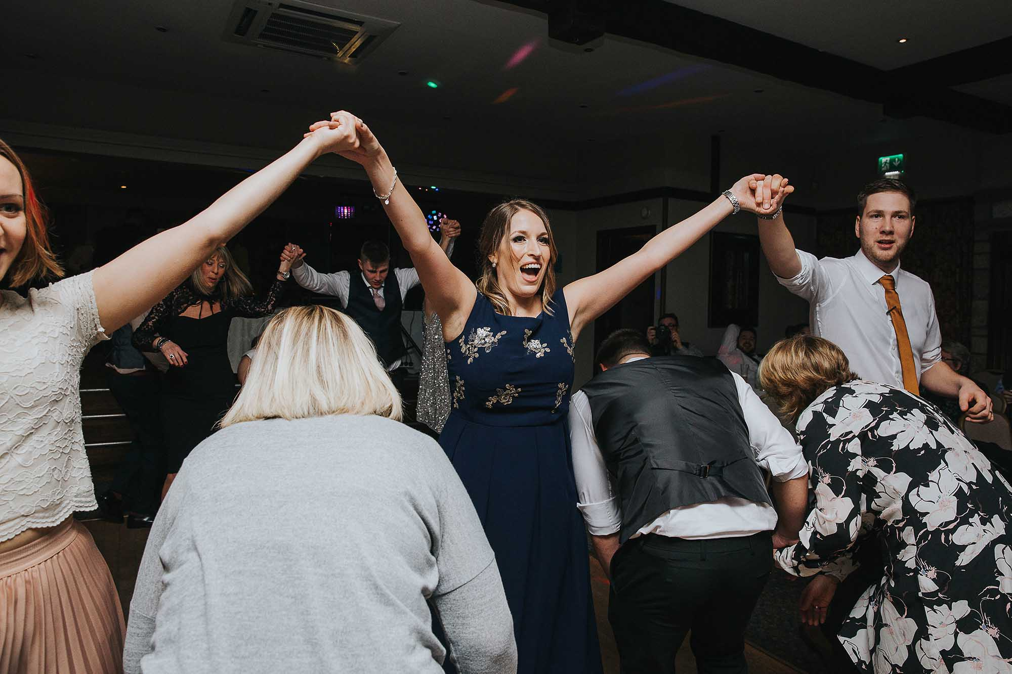 wedding guests dancing to Triple Scotch Ceilidh Band