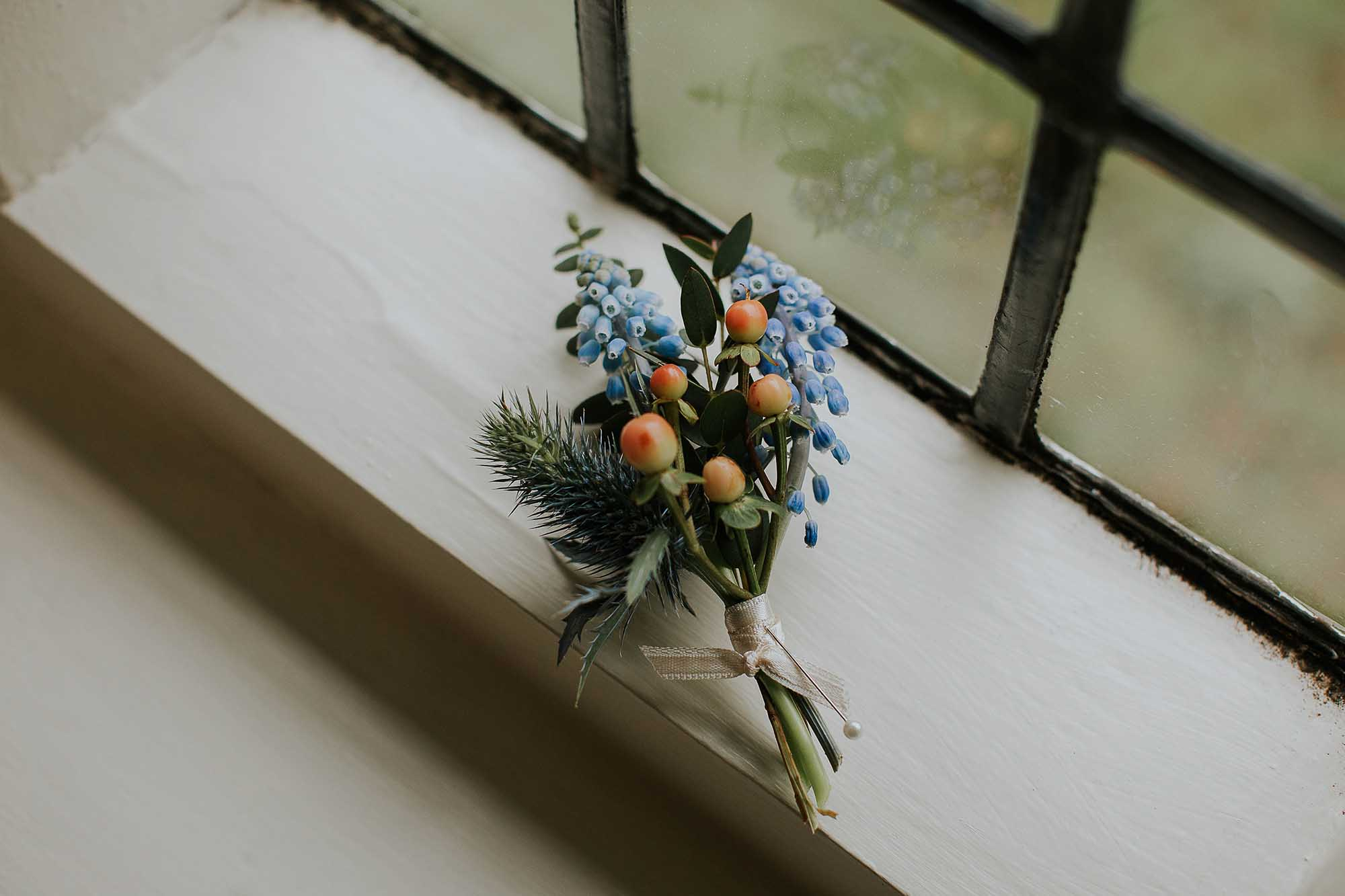 buttonhole by Campbells Flowers