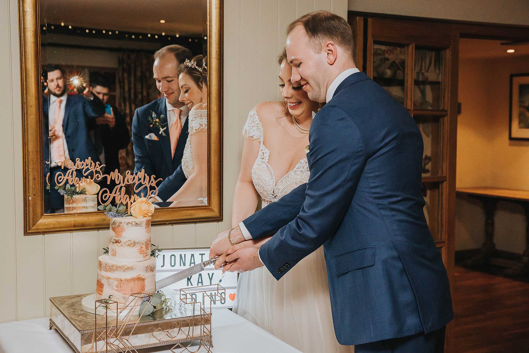 bride and groom cut the cake at The Black Swan Helmsley