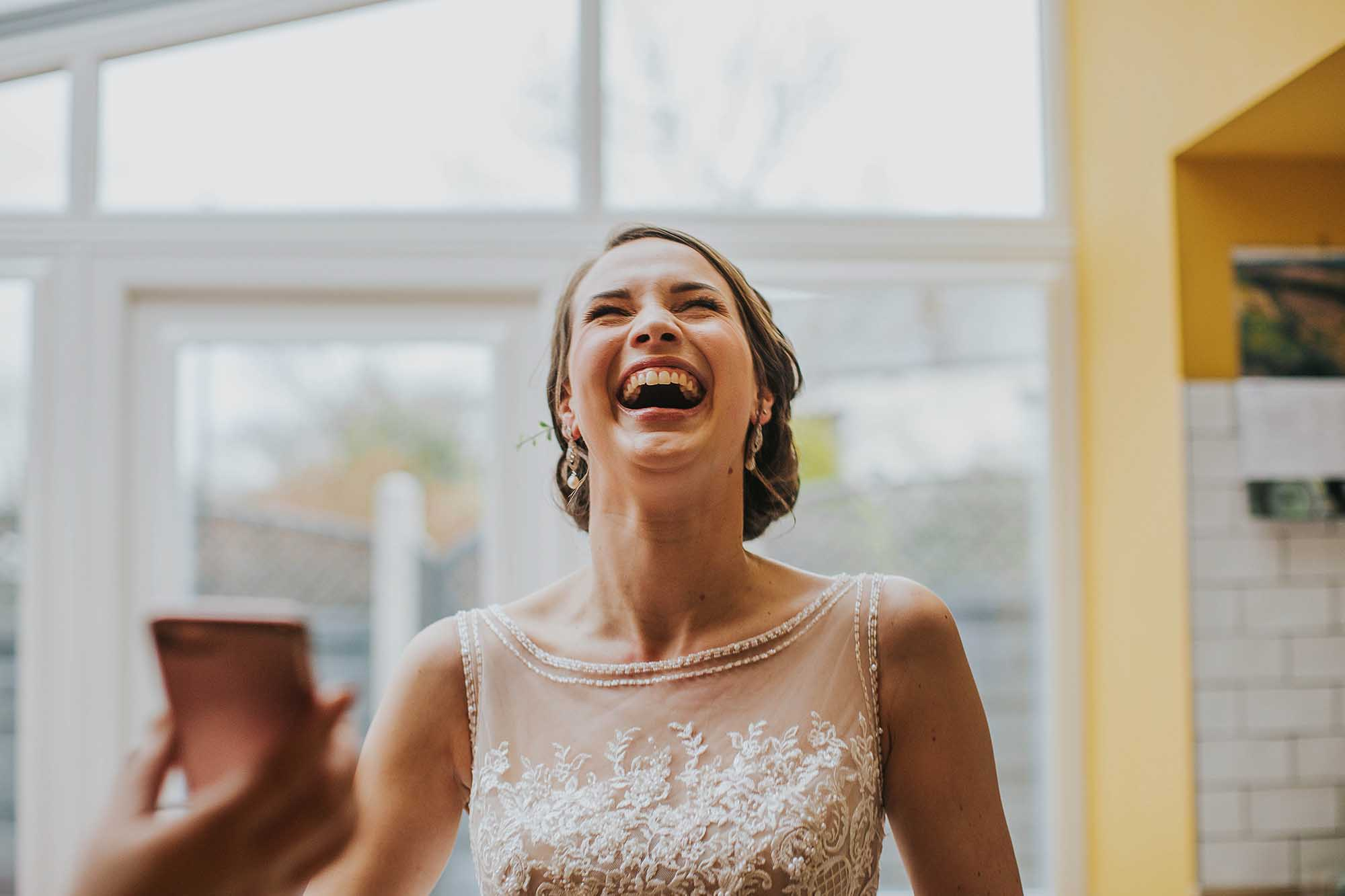 natural laughing wedding photography Greater Manchester