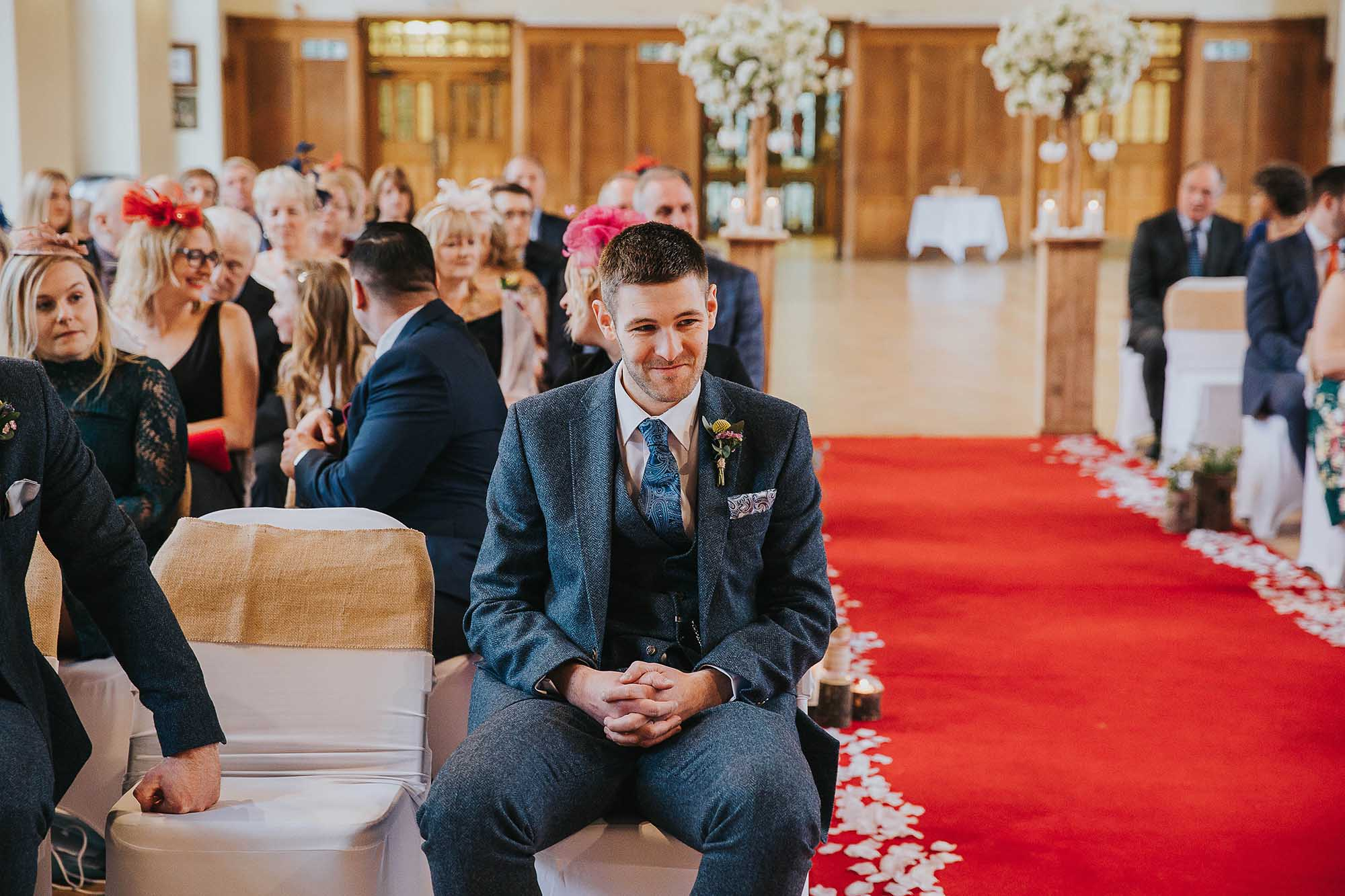 groom waiting at Bolton School wedding