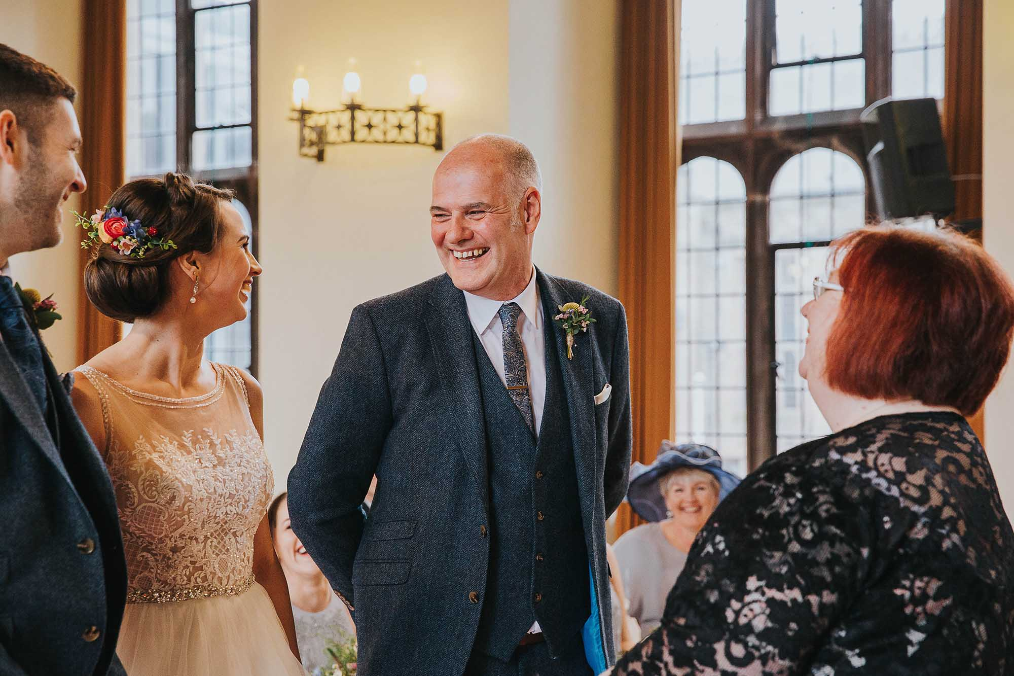 father of the bride during wedding ceremony at Bolton School