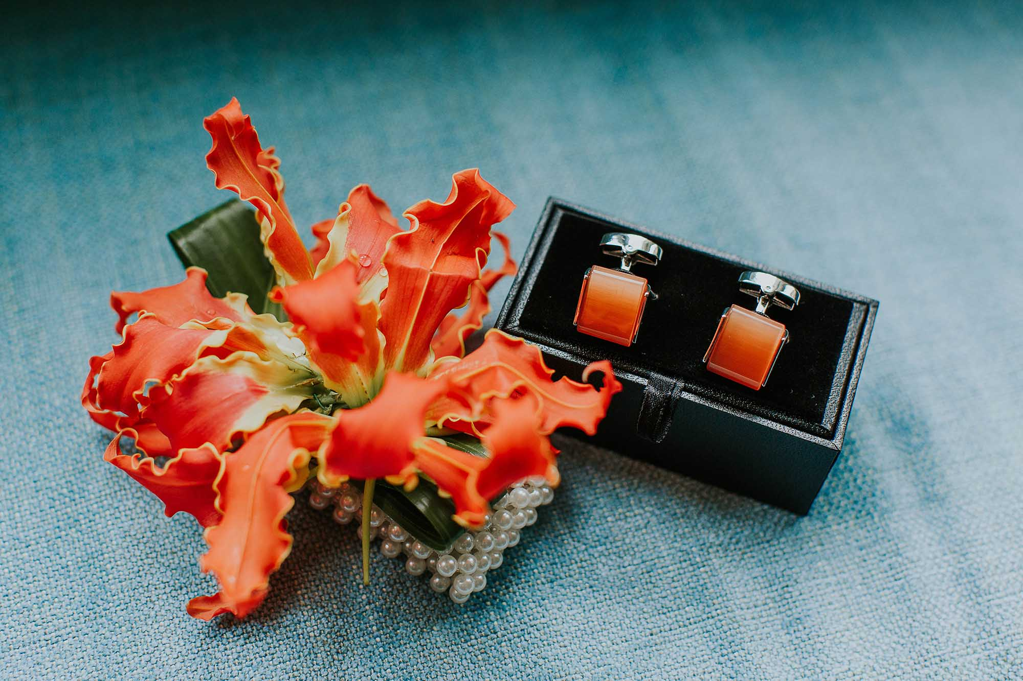 groom's orange cufflinks