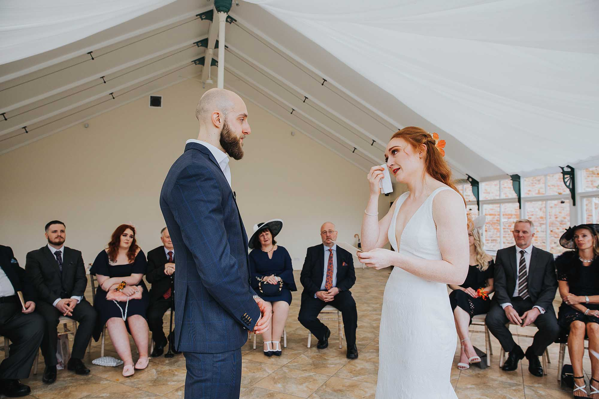 Combermere Abbey wedding ceremony in the glasshouse