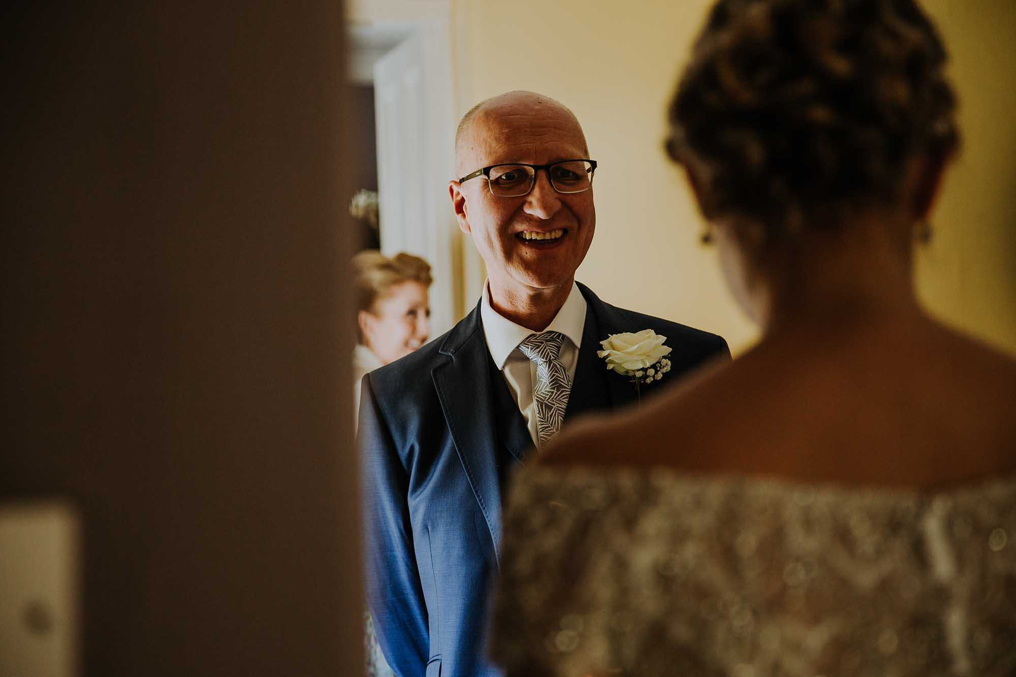 father of the bride sees bride Wales wedding