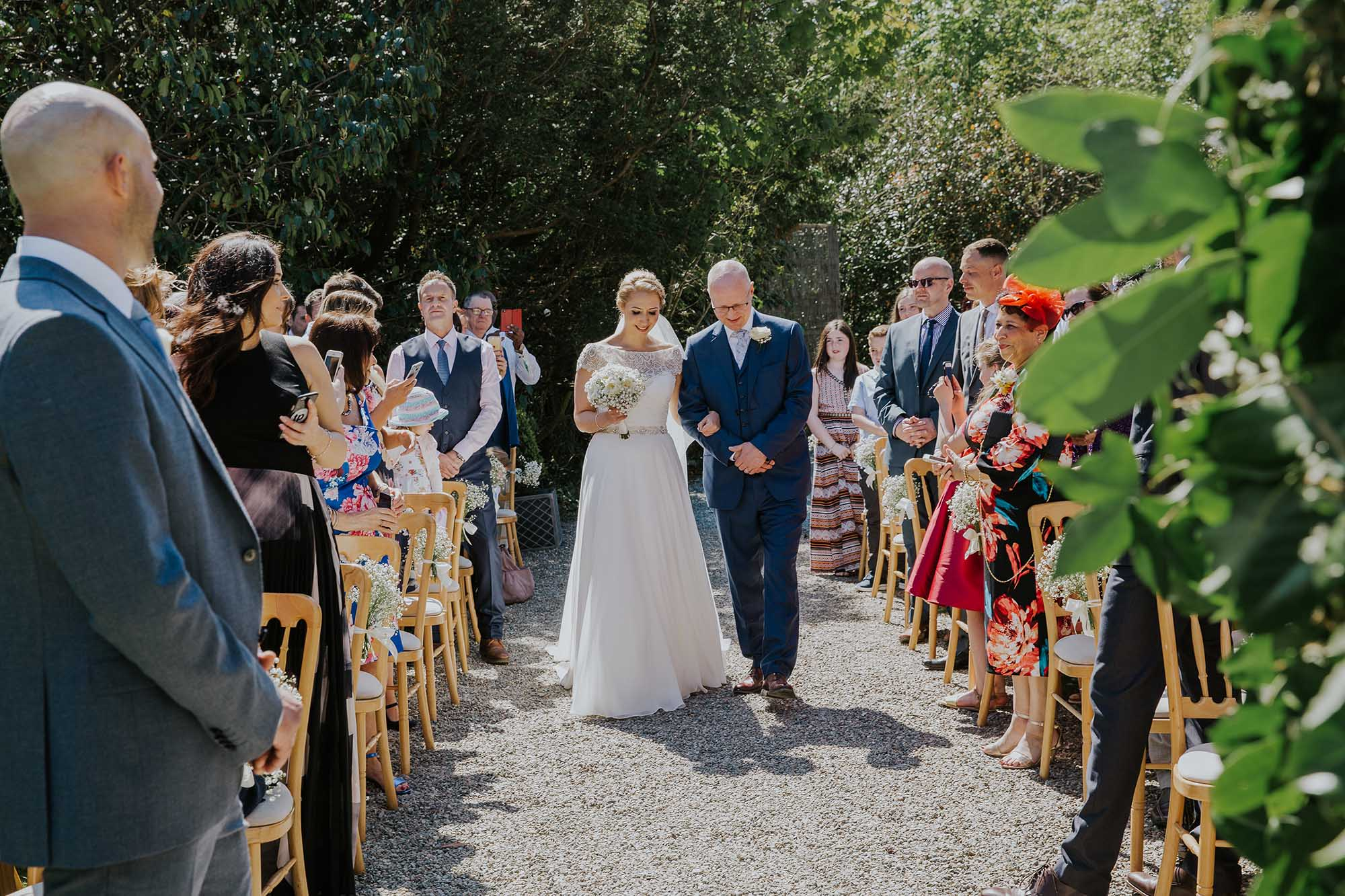 outdoor wedding ceremony at tros yr afon anglesey