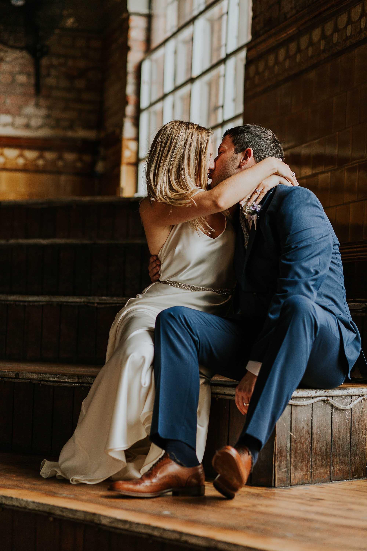 couple's wedding portraits inside the Albert Hall Manchester