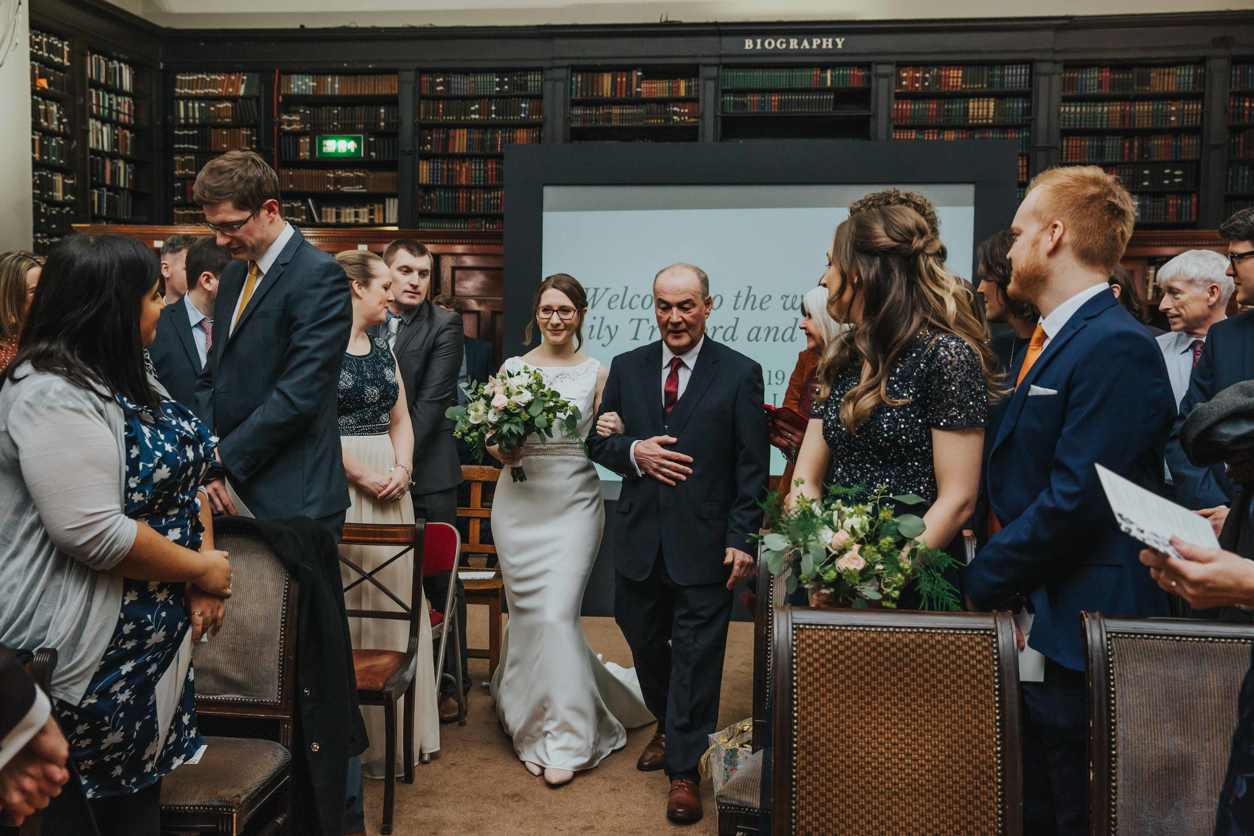Bride walking down the aisle at The Portico Library