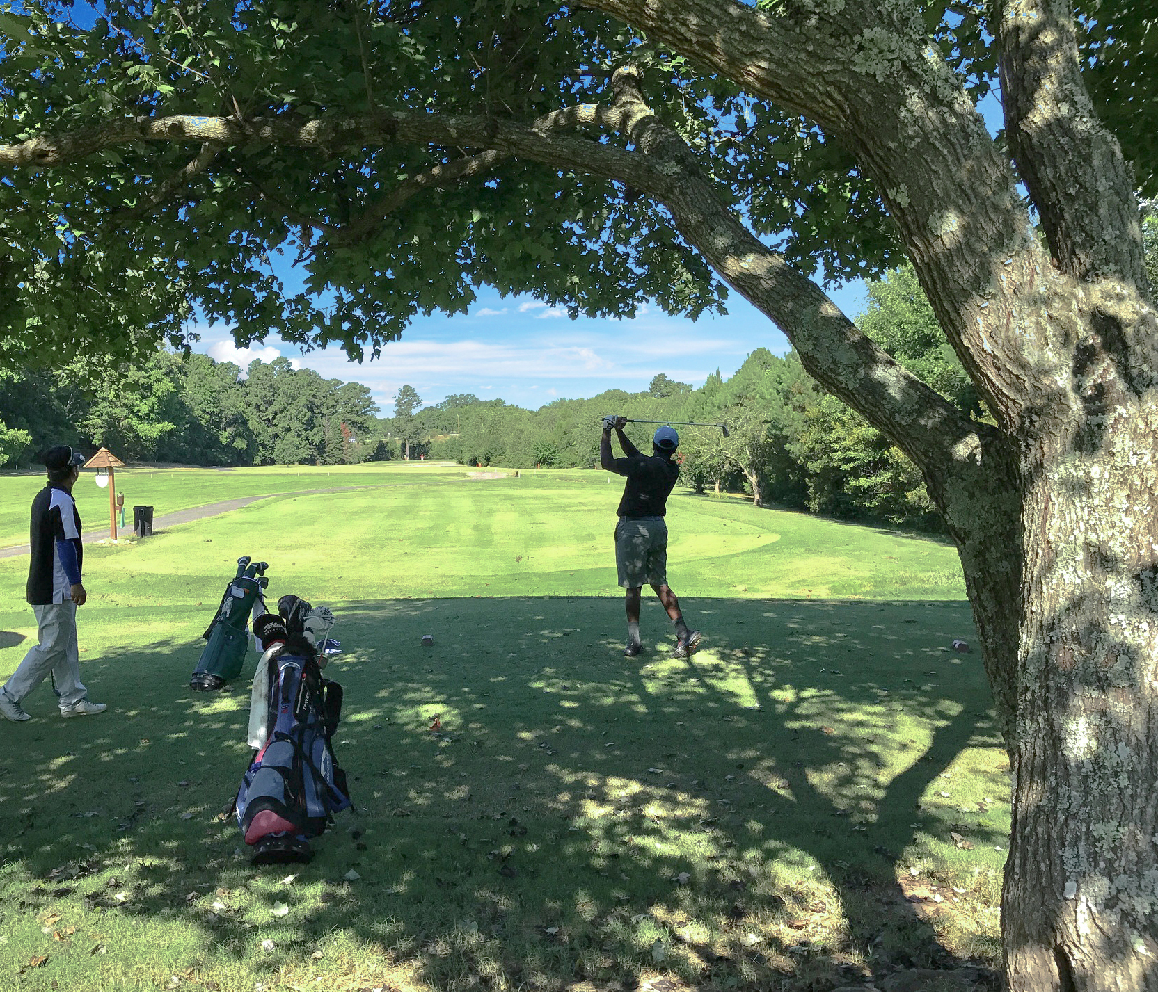 C.J. Paschall follows the flight of his tee shot on the fifth hole.