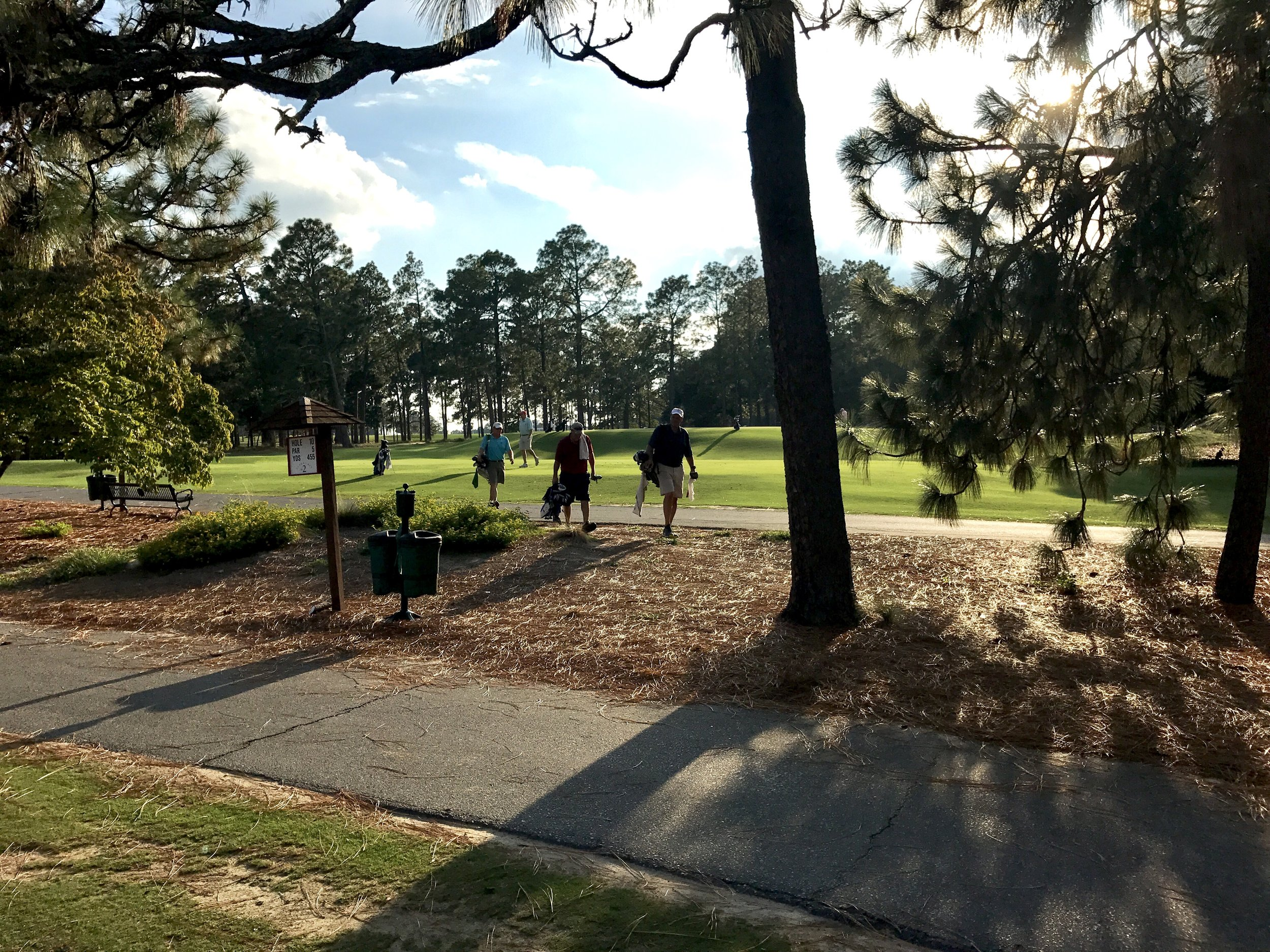 "Twilight is nigh as members of Pinehurst Country Club leave the ninth tee during a Tuesday afternoon ""Executive Golf"" outing."