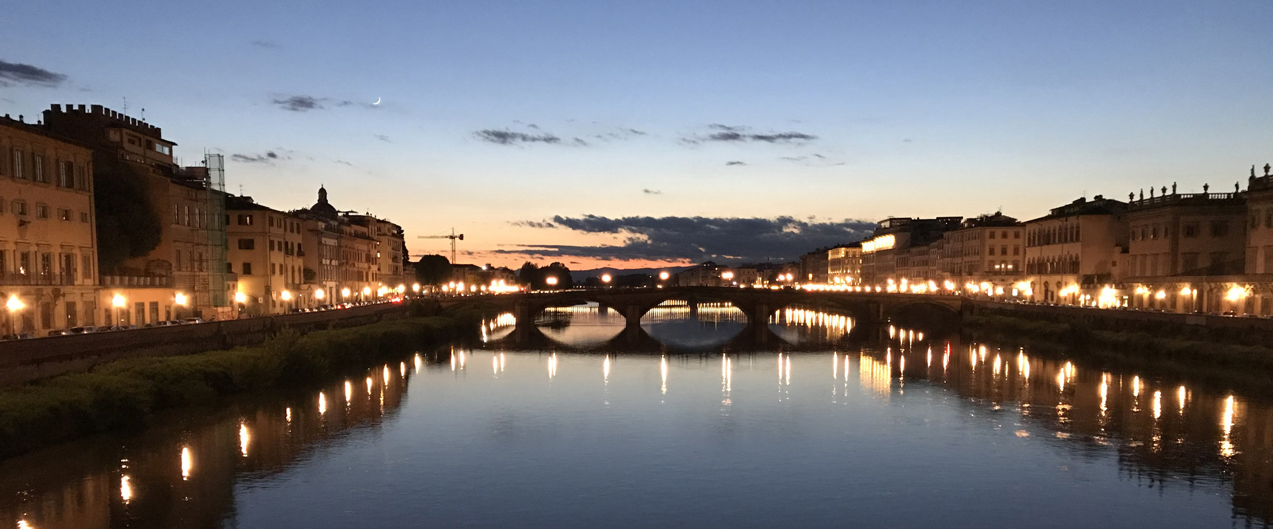 Sundown from one of the bridges crossing the Arno River in the heart of Florence.