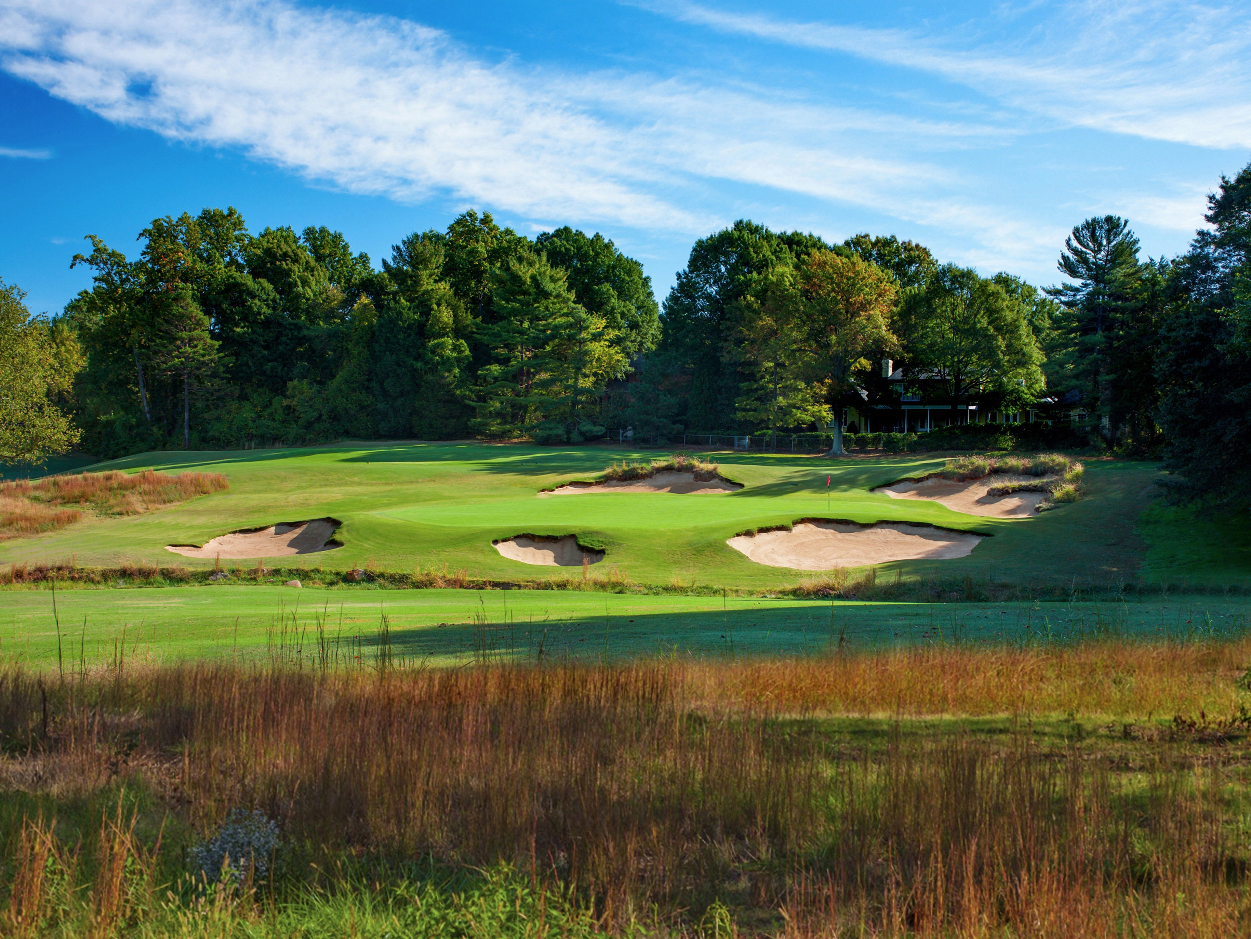 The latest iteration of the par-three second hole courtesy designer Bill Coore features unkempt-looking bunkers and native Yadkin River sand.