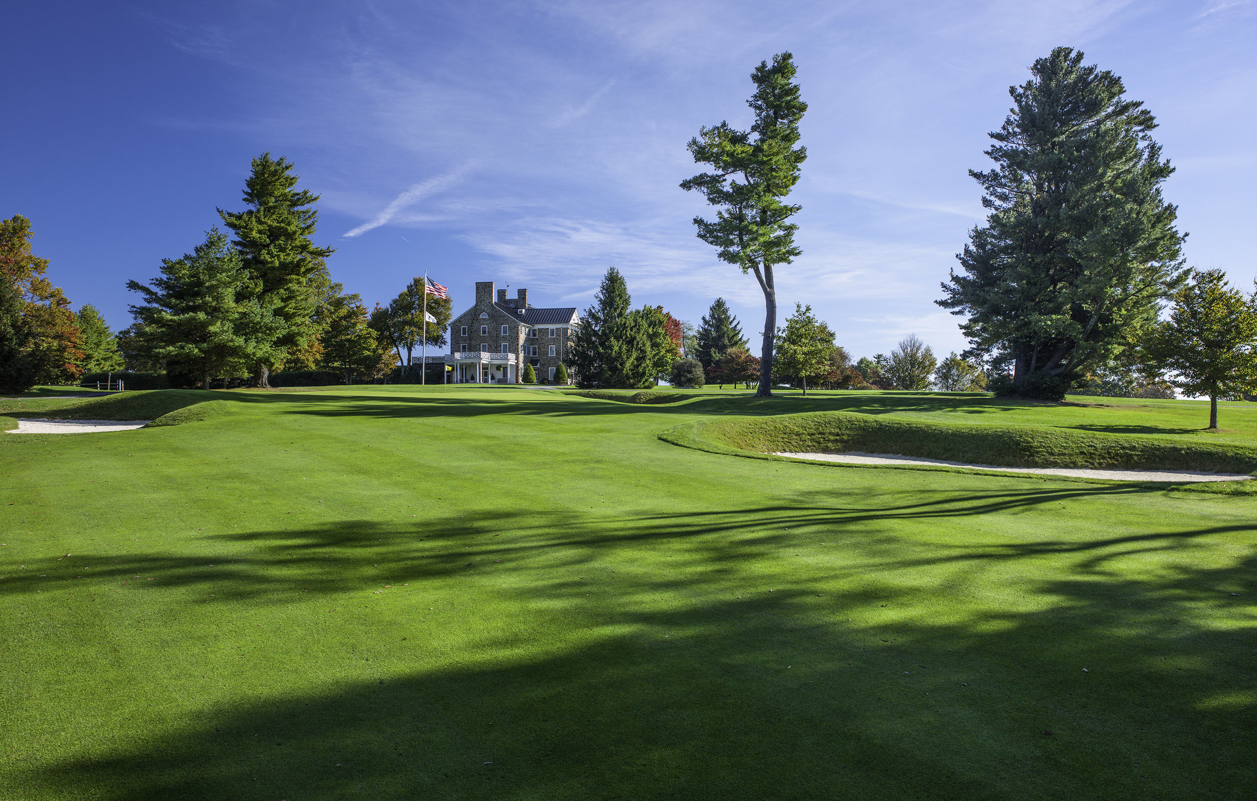 The stately Graystone Inn, the club's original lodging facility, looms in the backdrop of the uphill, par-four fourth hole.