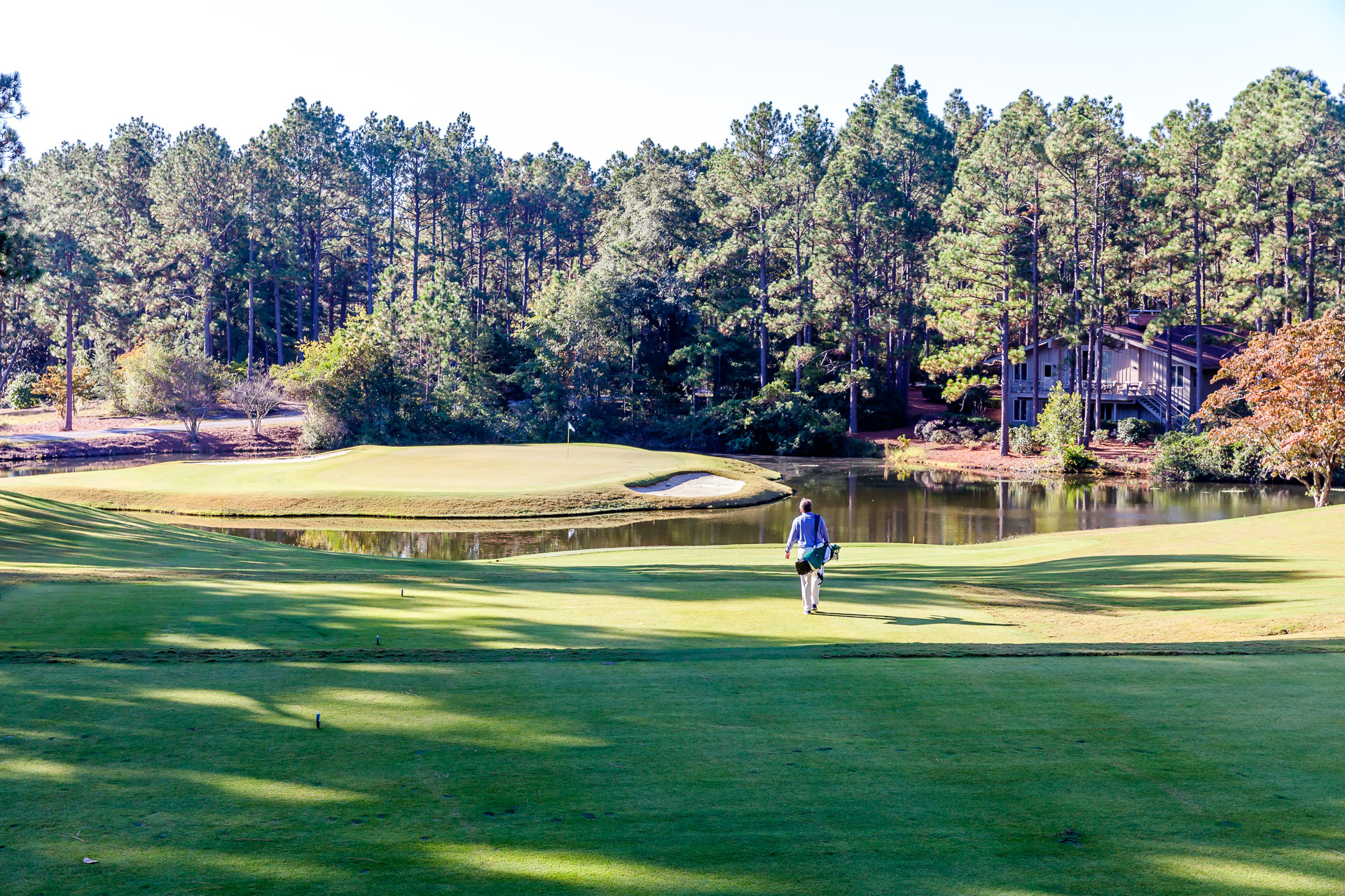 The author walking the third hole at the Country Club of North Carolina Dogwood Course, where long ago the club established a policy to promote and allow walking at all times.
