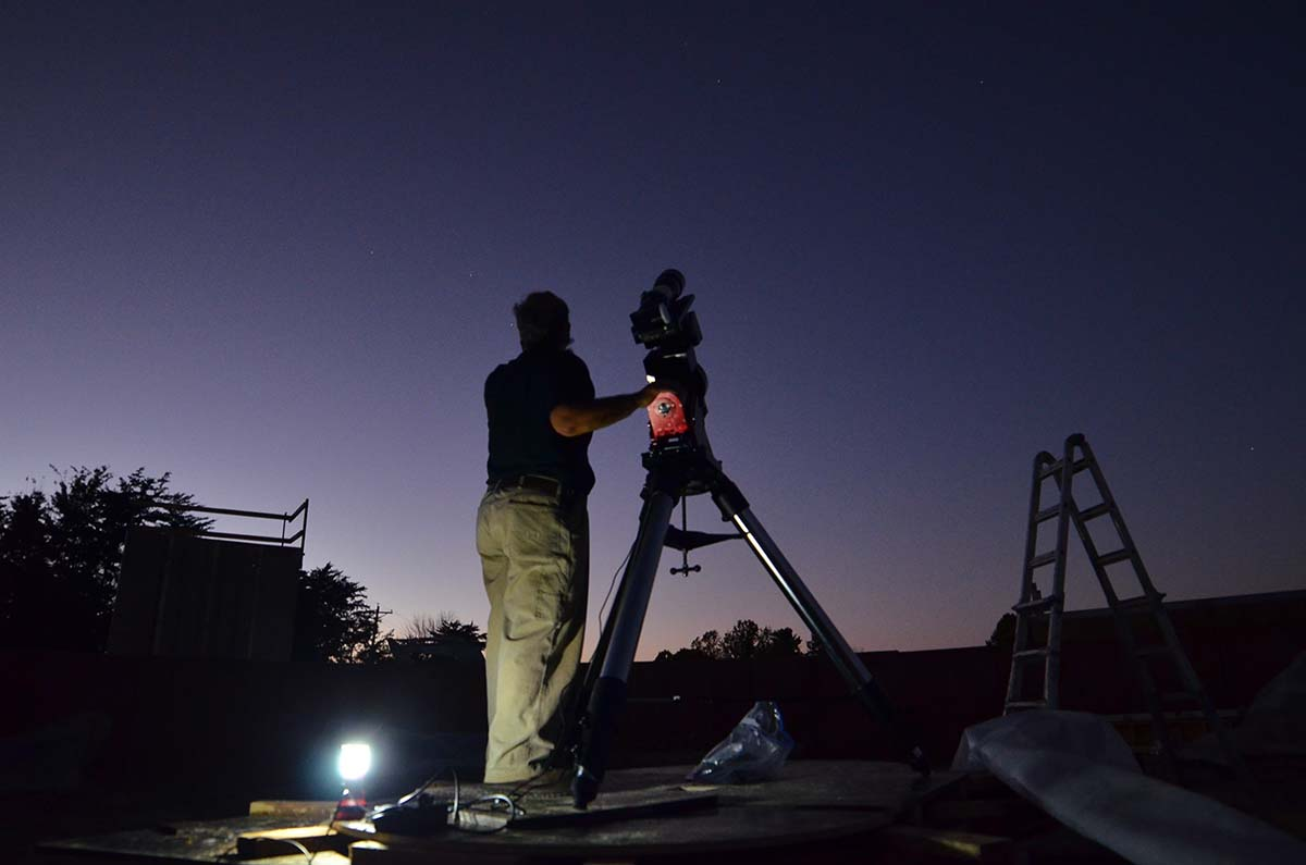Isaac Cruz aligns his telescope to the stars at the under-construction JGAP.