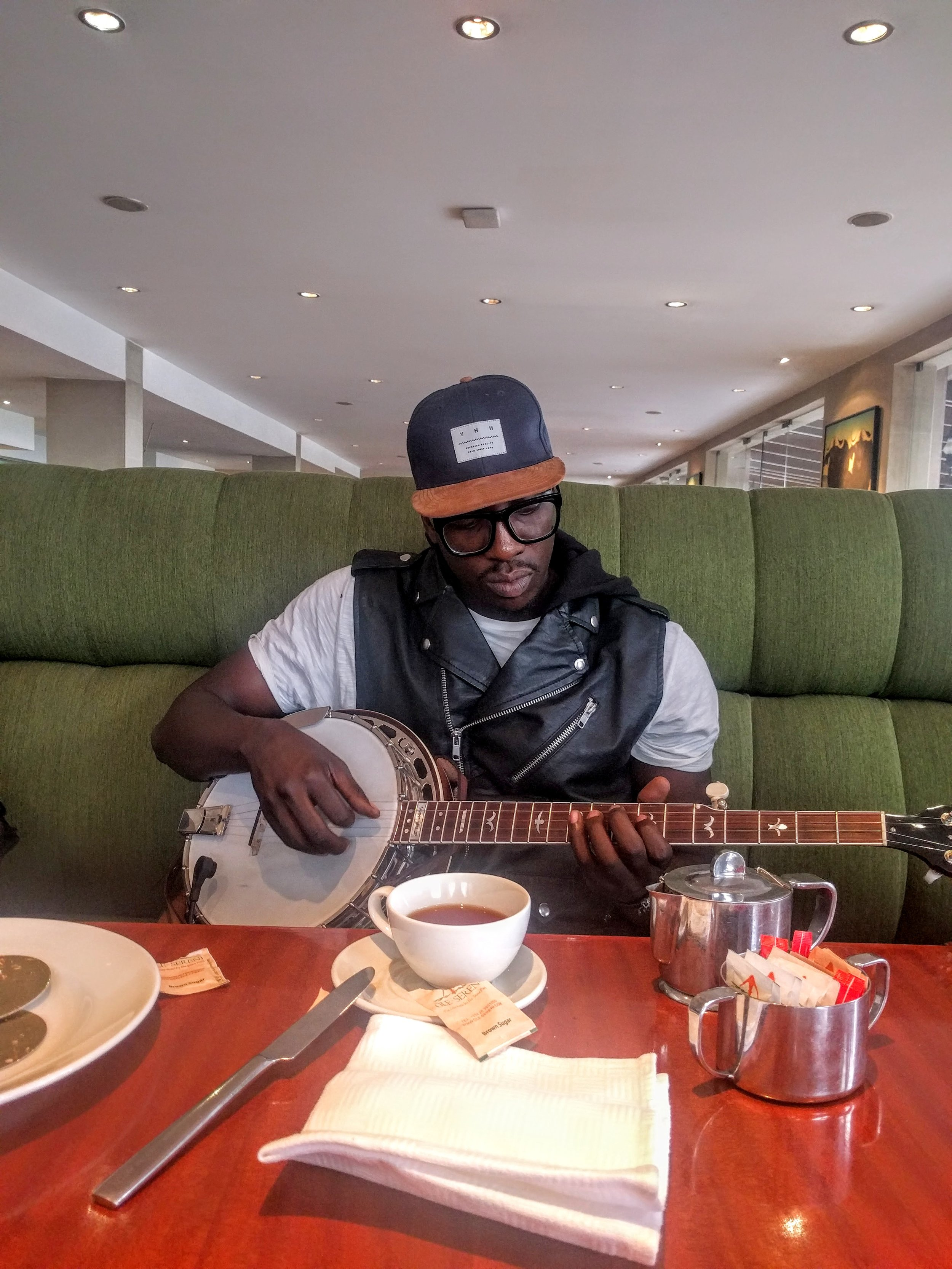 The incredibly talented Bien-Aimé Baraza from Sauti Sol trying out a banjo for the first time. He fell in love with it.