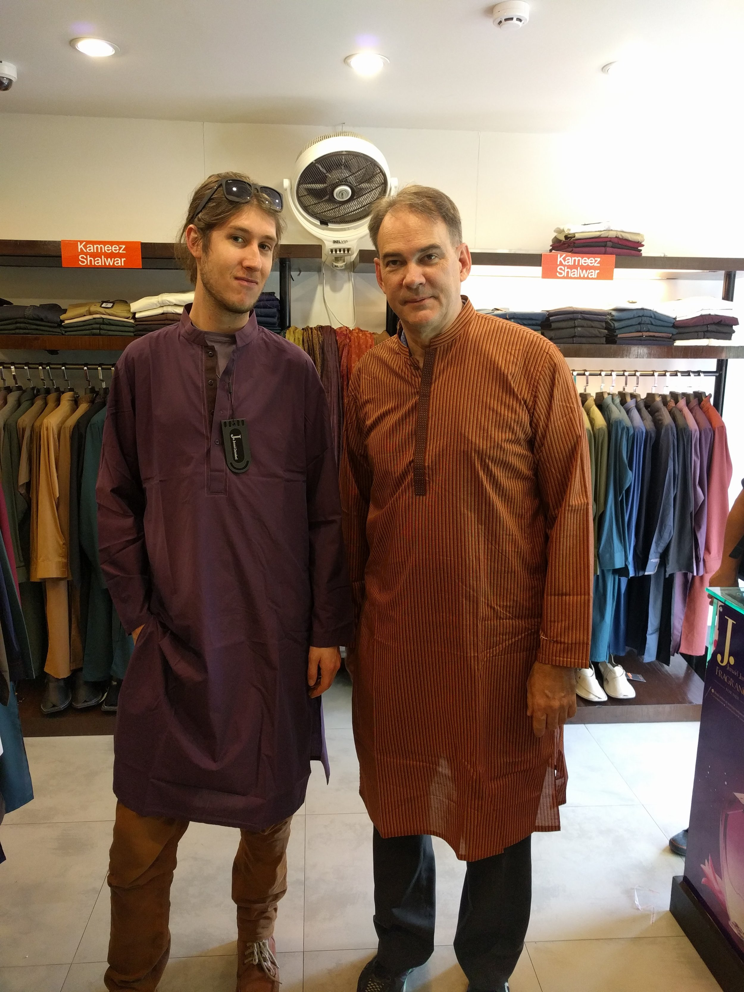 Kyle and John (our gracious host for the trip) stopped in to try on some traditional Pakistani clothing.