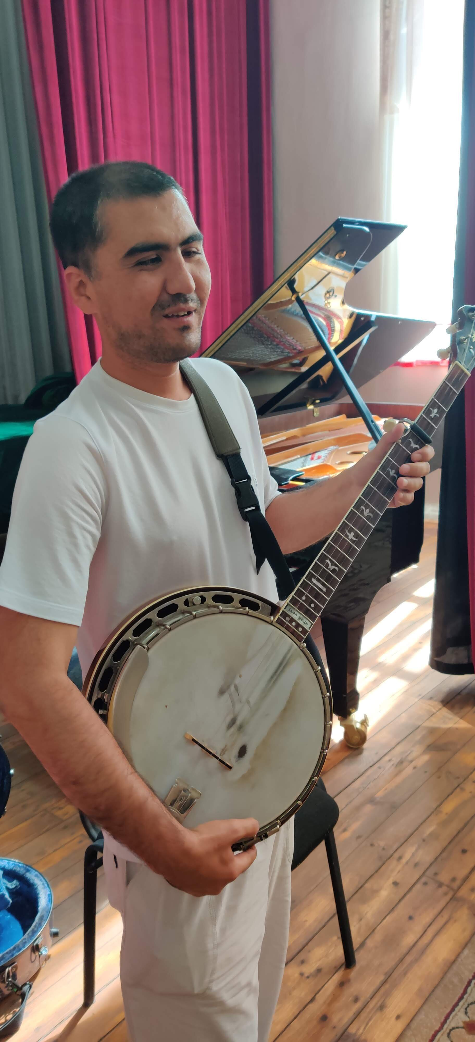 One of the teachers at the school was fascinated with the sound of the banjo and wanted to give it a try.