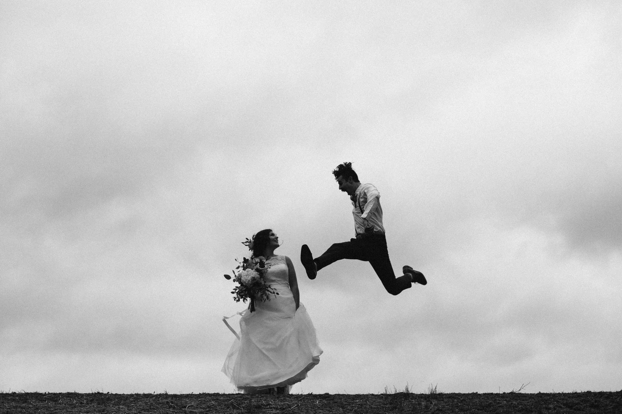 She keeps him grounded... - Cory & Olivia's wedding was our first we photographed together. If anyone knows Cory, they know this photo sums up his energy accurately. Olivia, full of wisdom & grace, compliments his high-energy spunk perfectly. Their love spurs each other on to love others selflessly.