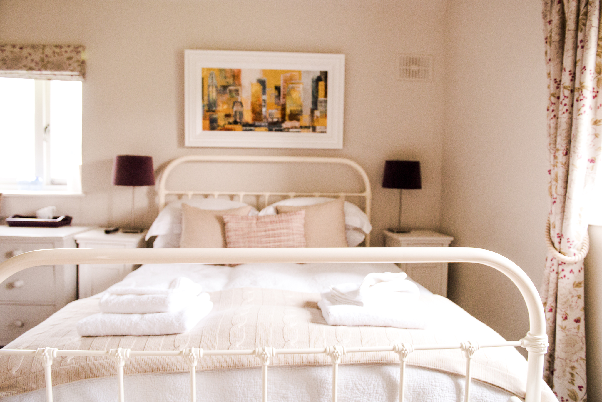 Room 3 - Room 3 is one of our most spacious rooms. This corner-side bedroom has large windows on both walls overlooking at The South Downs National Park, a large comfortable bed,a large sofa, and a private bathroom with a luxurious shower.This room can only be booked as a double.
