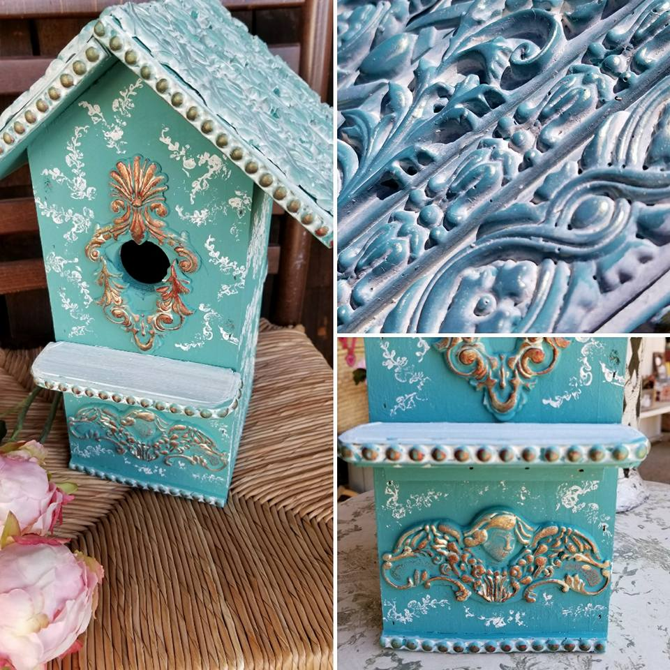 Adding the IOD moulds to this plain birdhouse allows you to add as much detail as you please. The moulds make it possible to create an elegant look on an ordinary surface in no time at all. Even the roof was covered with decorative strips and highlighted with a whitewash. Use IOD paper clay for best results...