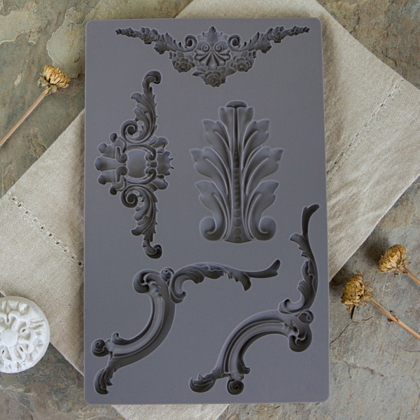 Iron Orchid Designs moulds are made of silicone. They can be used with a variety of materials and they are food safe too. They can be used for cakes, chocolates, etc..  Baroque 4-814809
