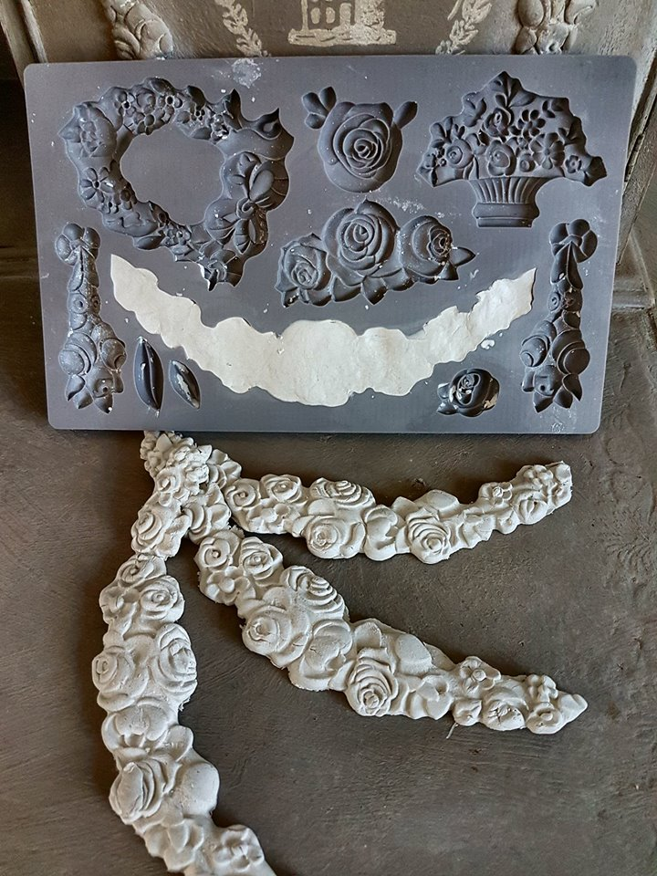 Magdalena used the IOD Fleur mould and made castings to add to her piece. You can use IOD paper clay for furniture pieces such as this. The clay is very durable once it dries, it takes any kind of medium you throw at it and it picks up every detail in the moulds perfectly...
